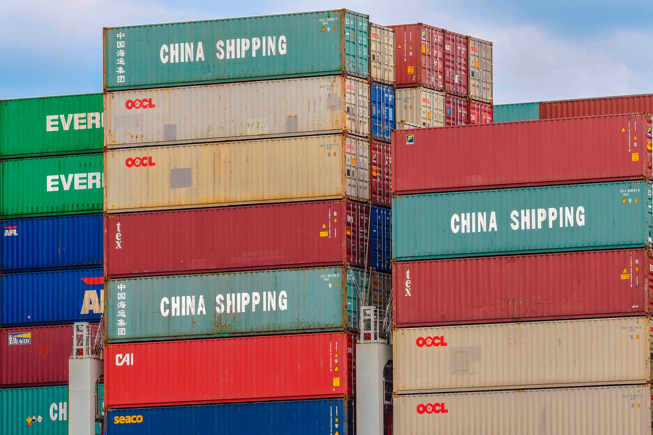Shipping containers with China stamped on them.