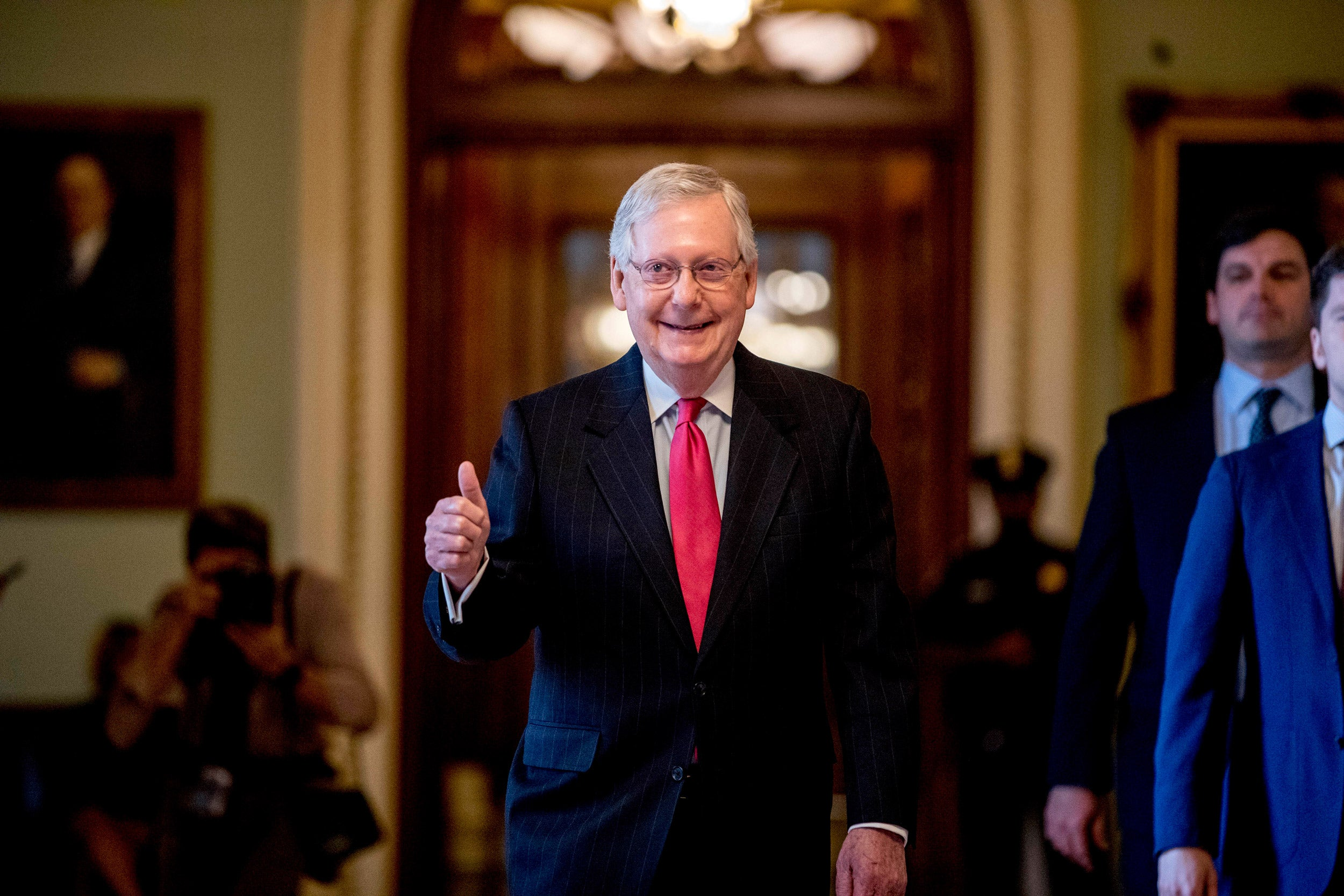 Senate Majority Leader Mitch McConnell gives a thumbs up