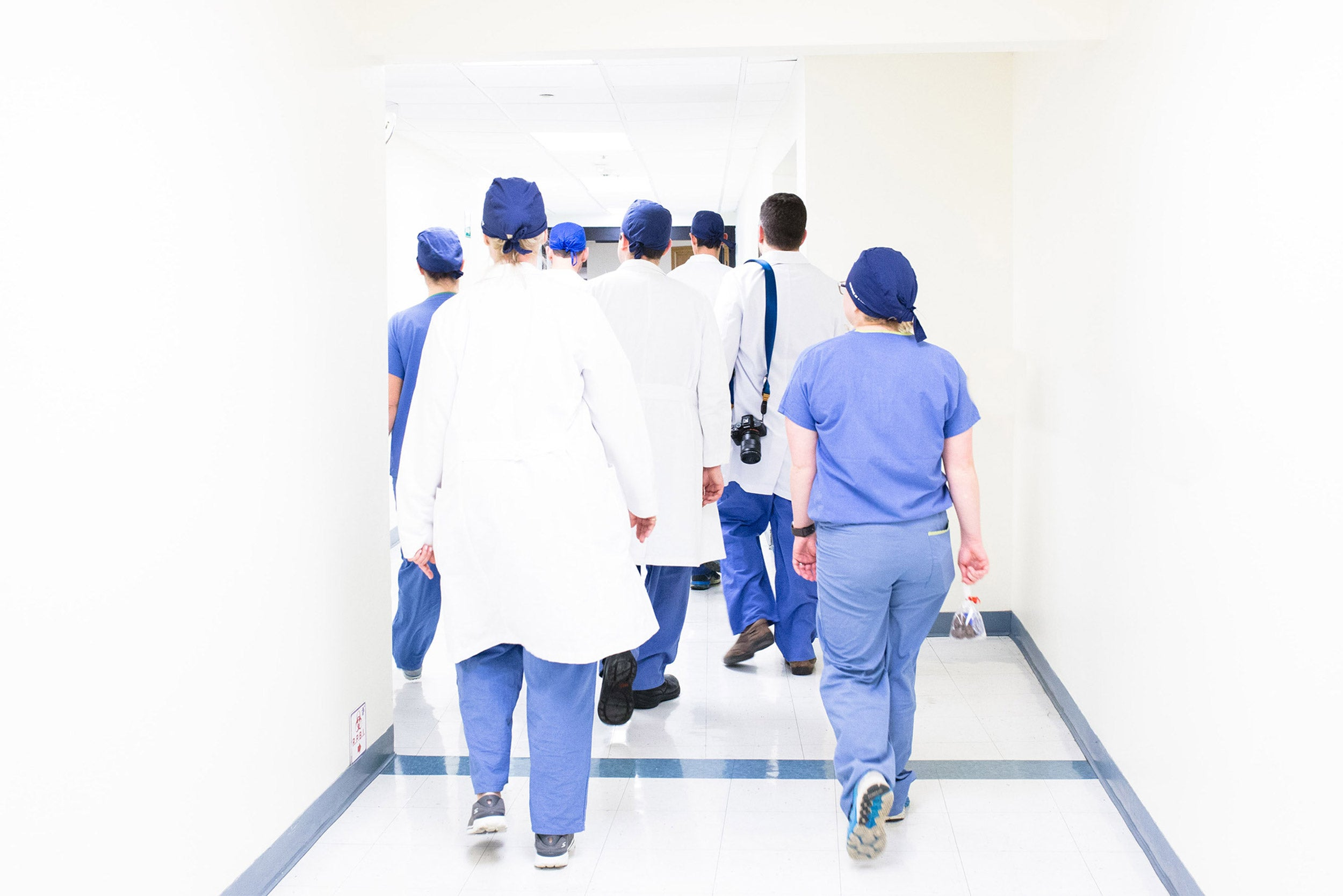Doctors and nurses walking down a corridor.