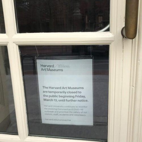 Museum door with sign.