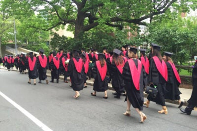 Harvard Medical School graduates walking,
