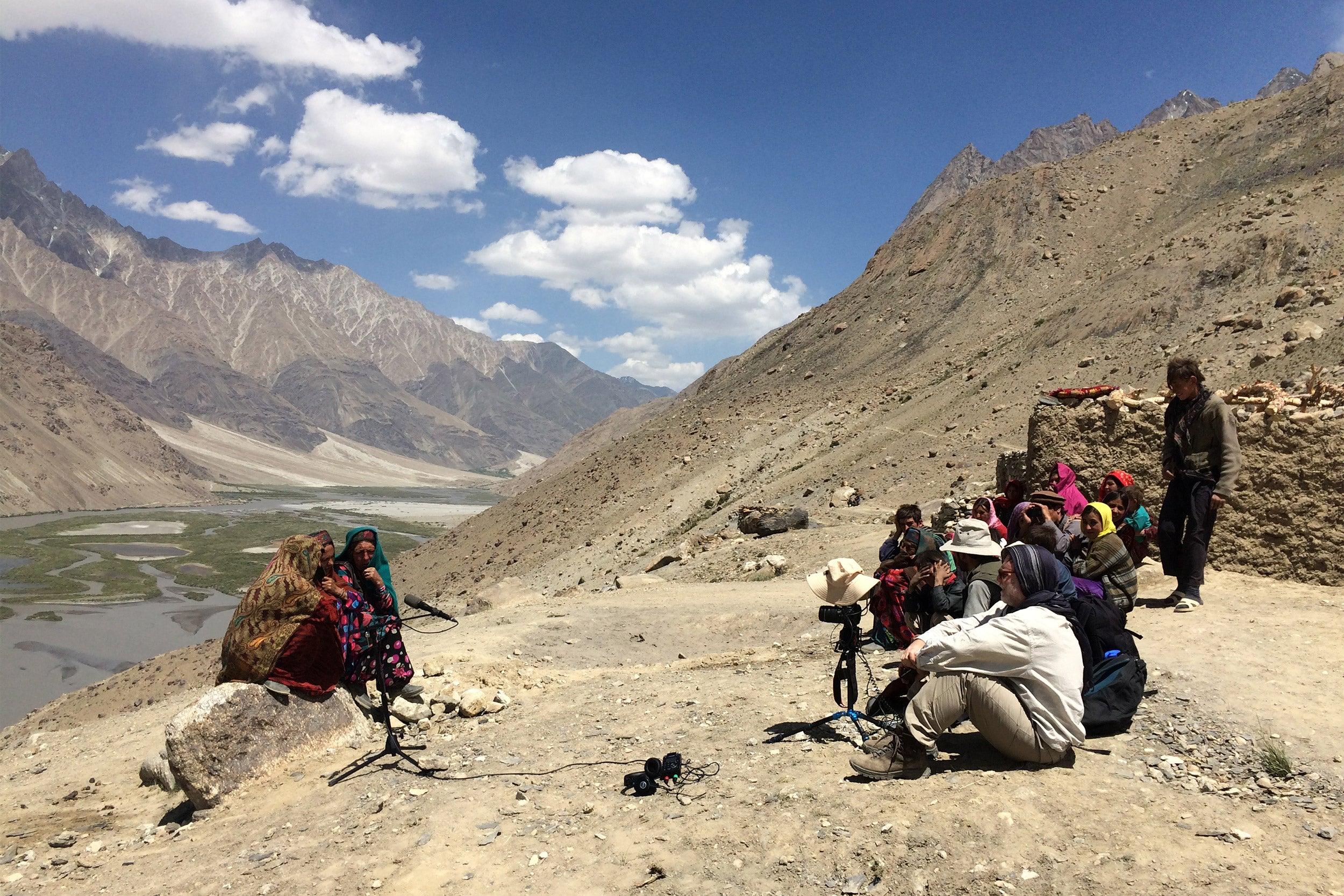 "Richard Wolf and villagers recording Wakhi women singing ""bulbulik."""