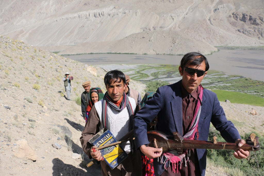Daulatsho, Yarqub and others playing their instruments and singing as they climb from Yur village to the ayloq.
