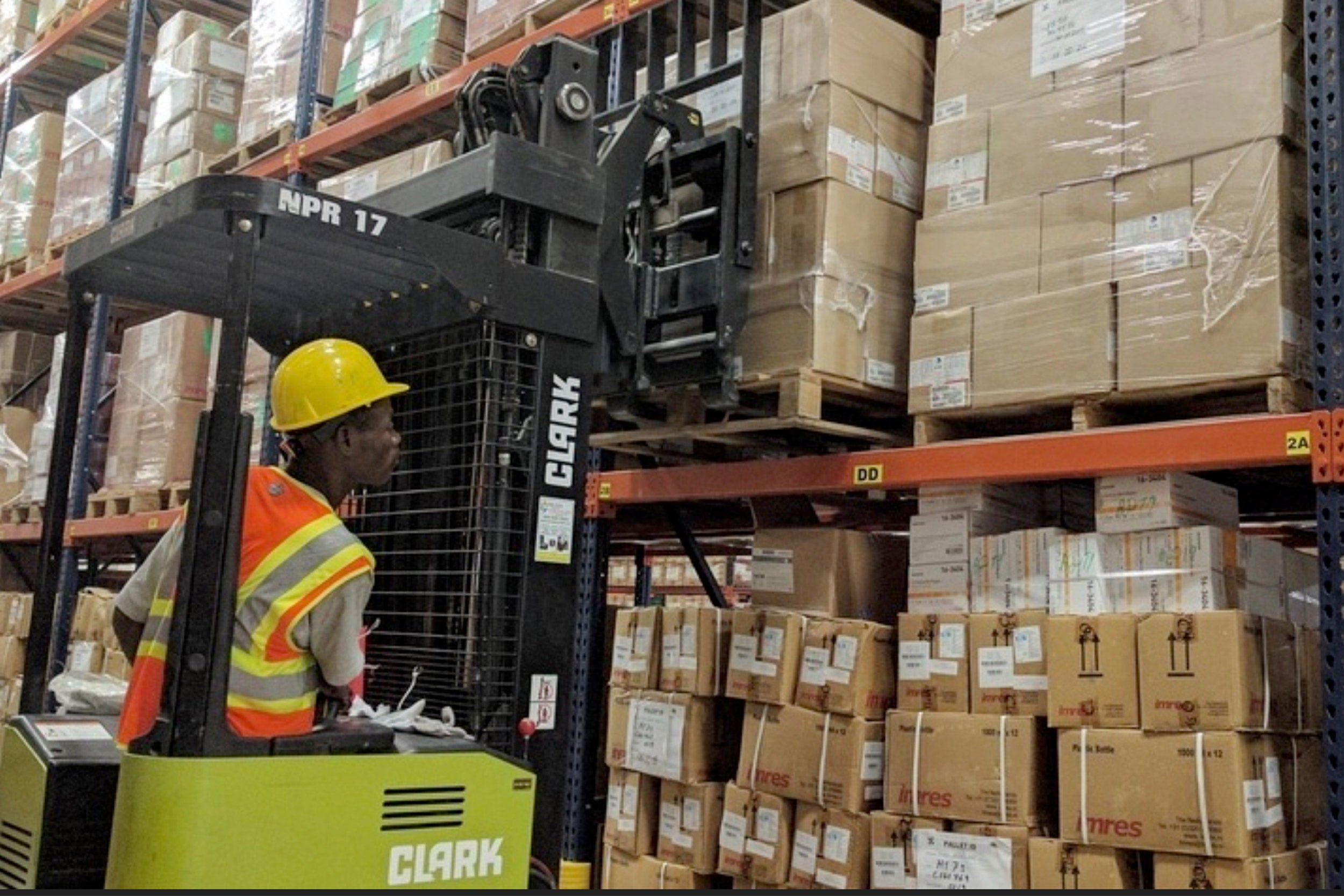 Man in supply warehouse.
