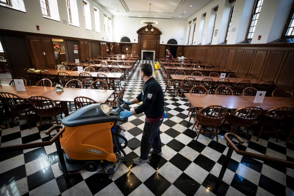 Custodian cleaning dining room.