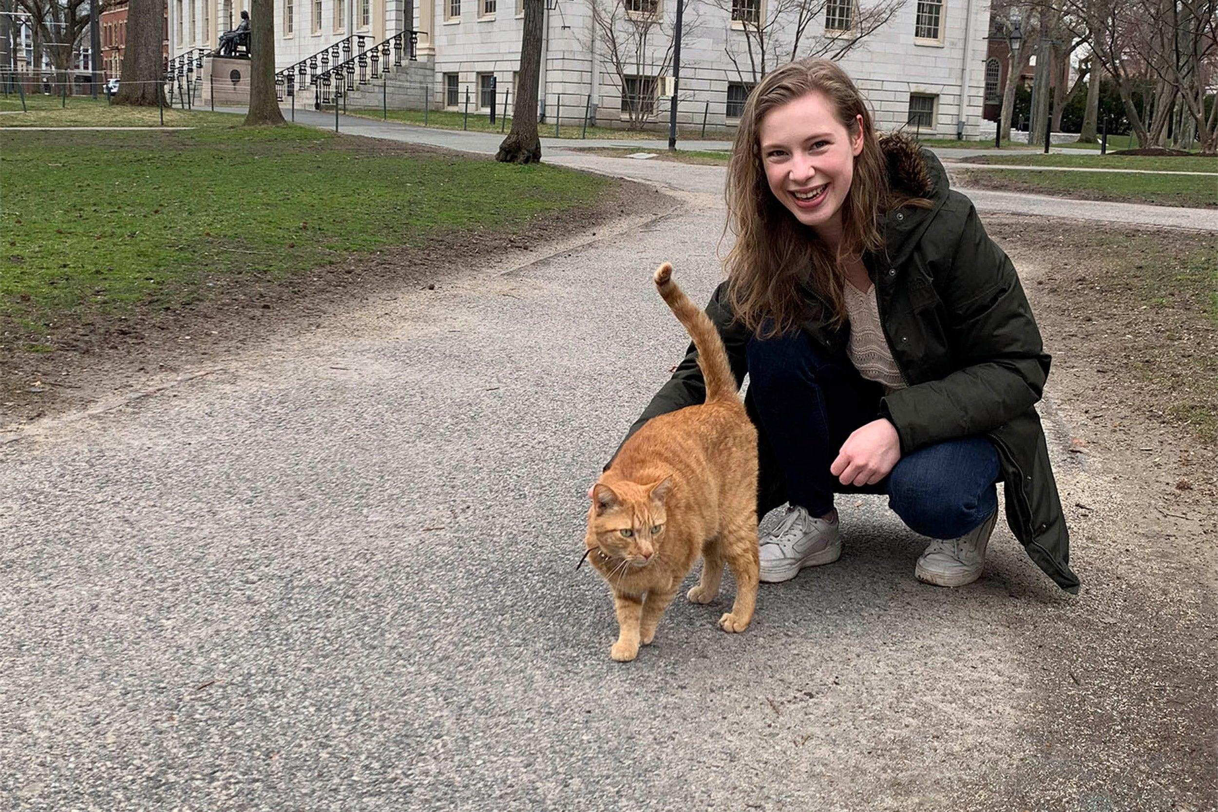 Barbara Oedayrajsingh Varma with Remy the cat.