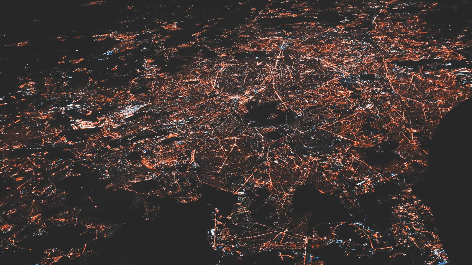 View from above of city network of lights.