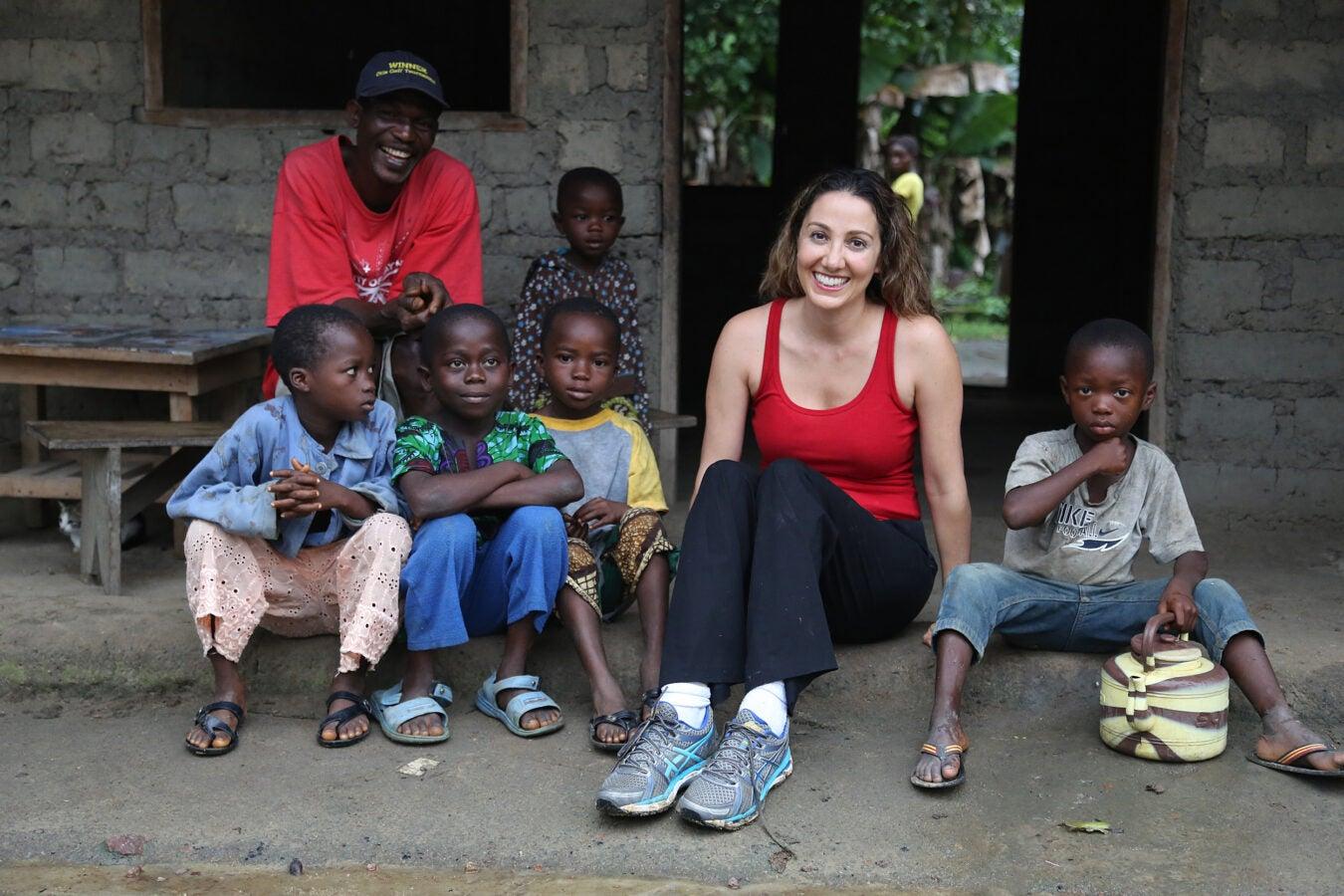 Sabeti with children in Sierra Leone.