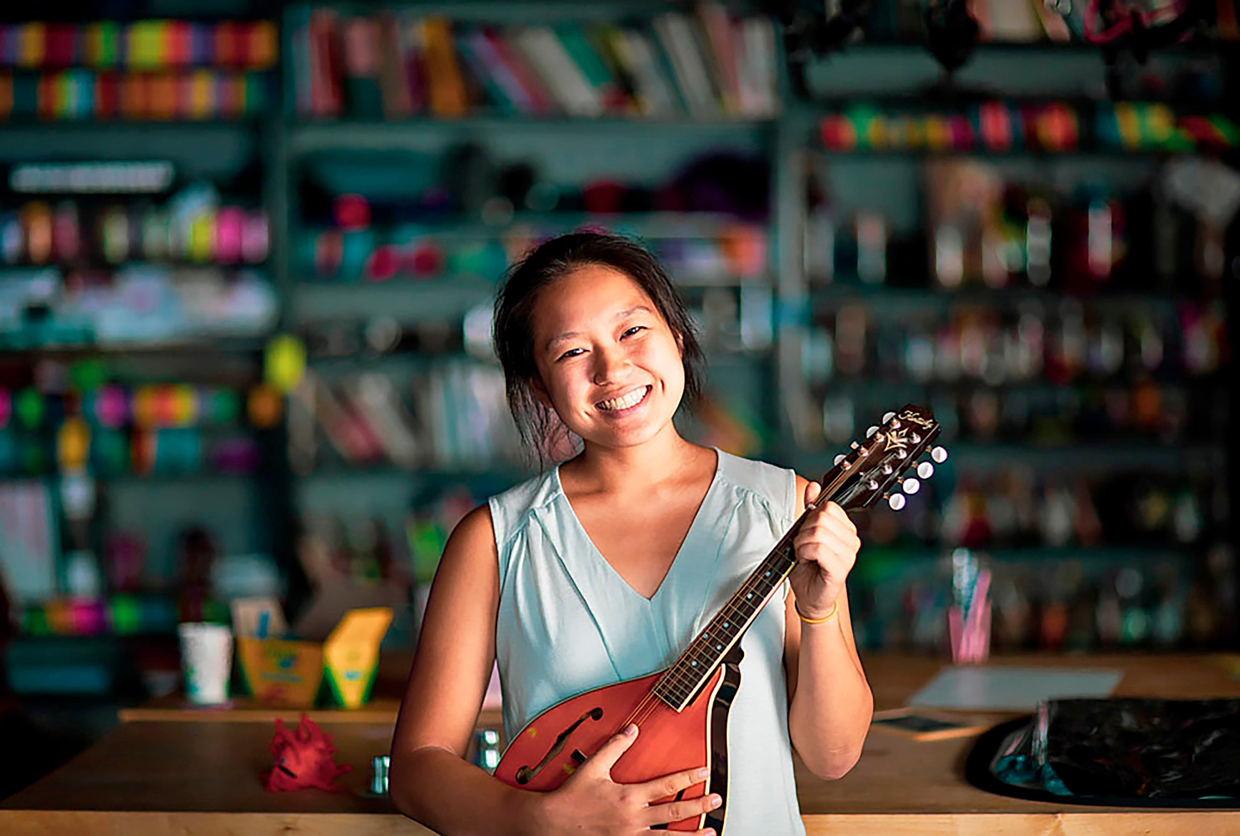 WHRB president Allison Pao '21, at the station with her mandolin.