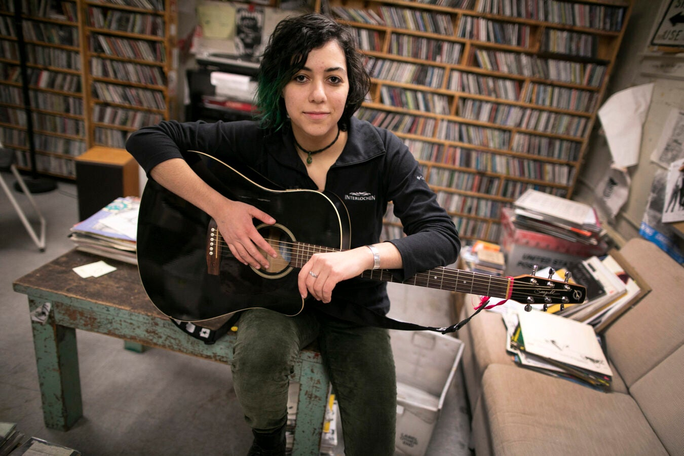 Emily Spector is pictured in the WHRB studio with her guitar.