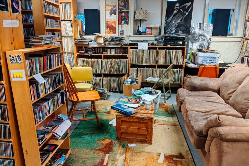 WHRB studios with shelves of albums are pictured.