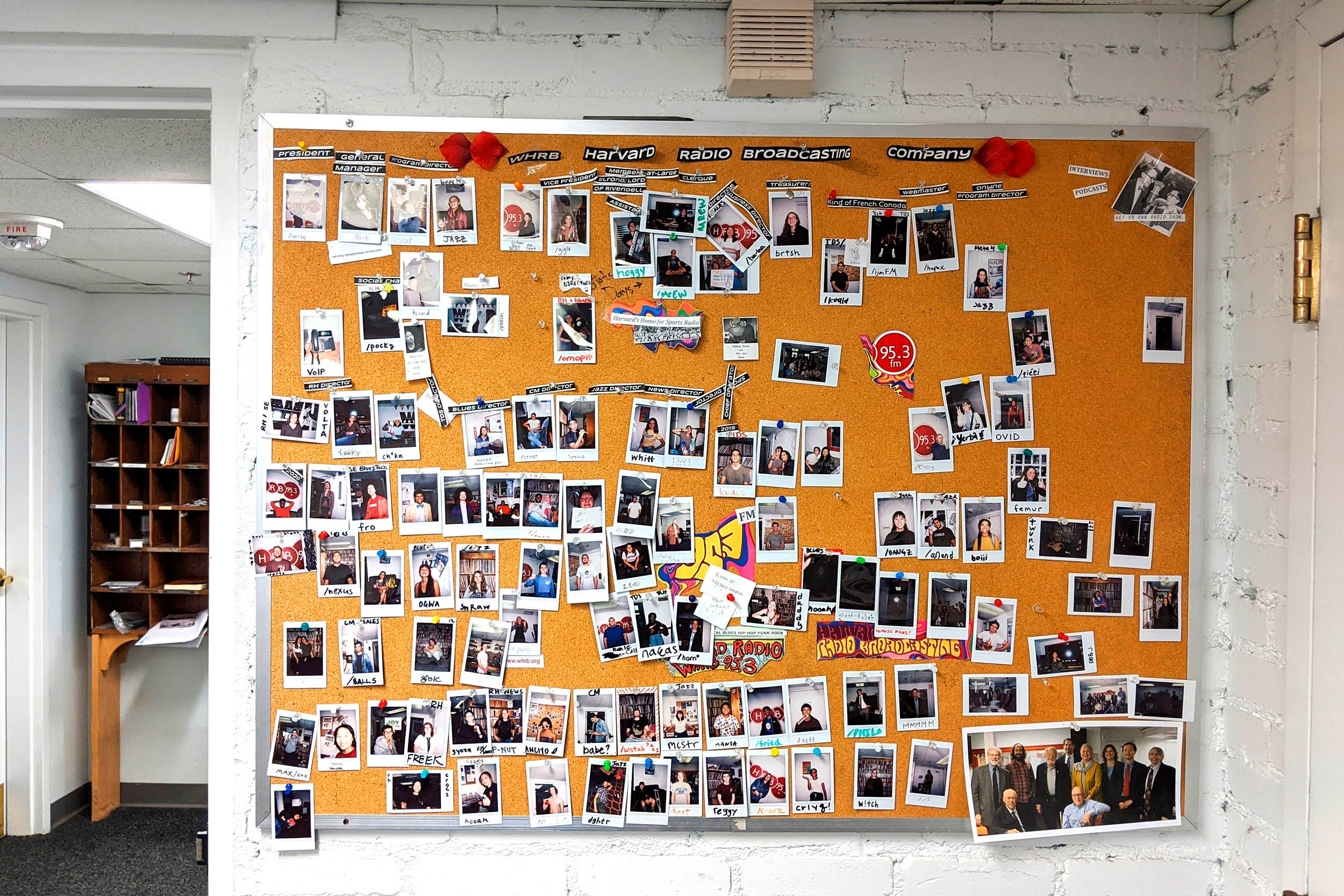 WHRB studios with photos on a bulletin board are pictured.
