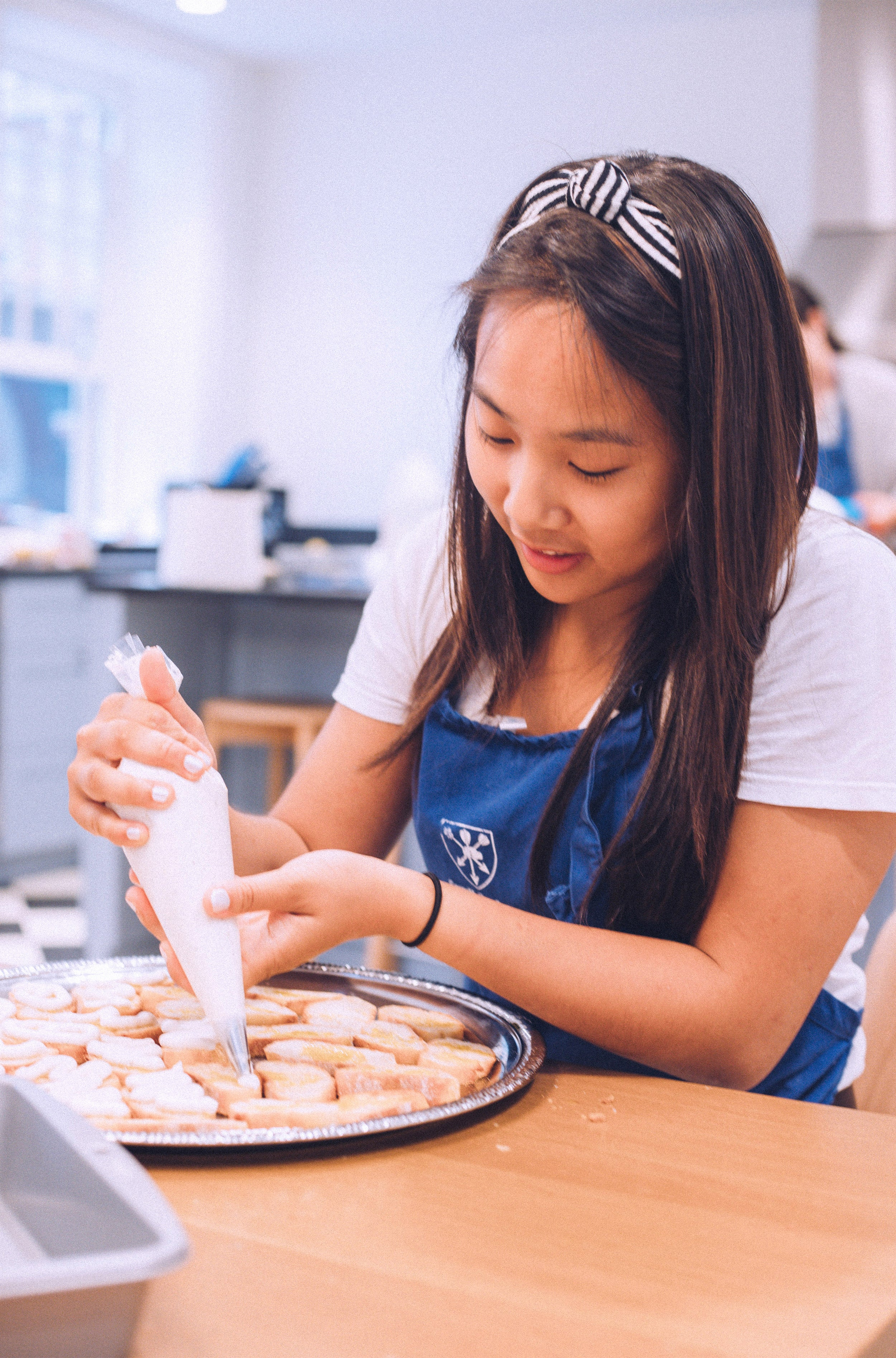 Meredith Pong cooking.
