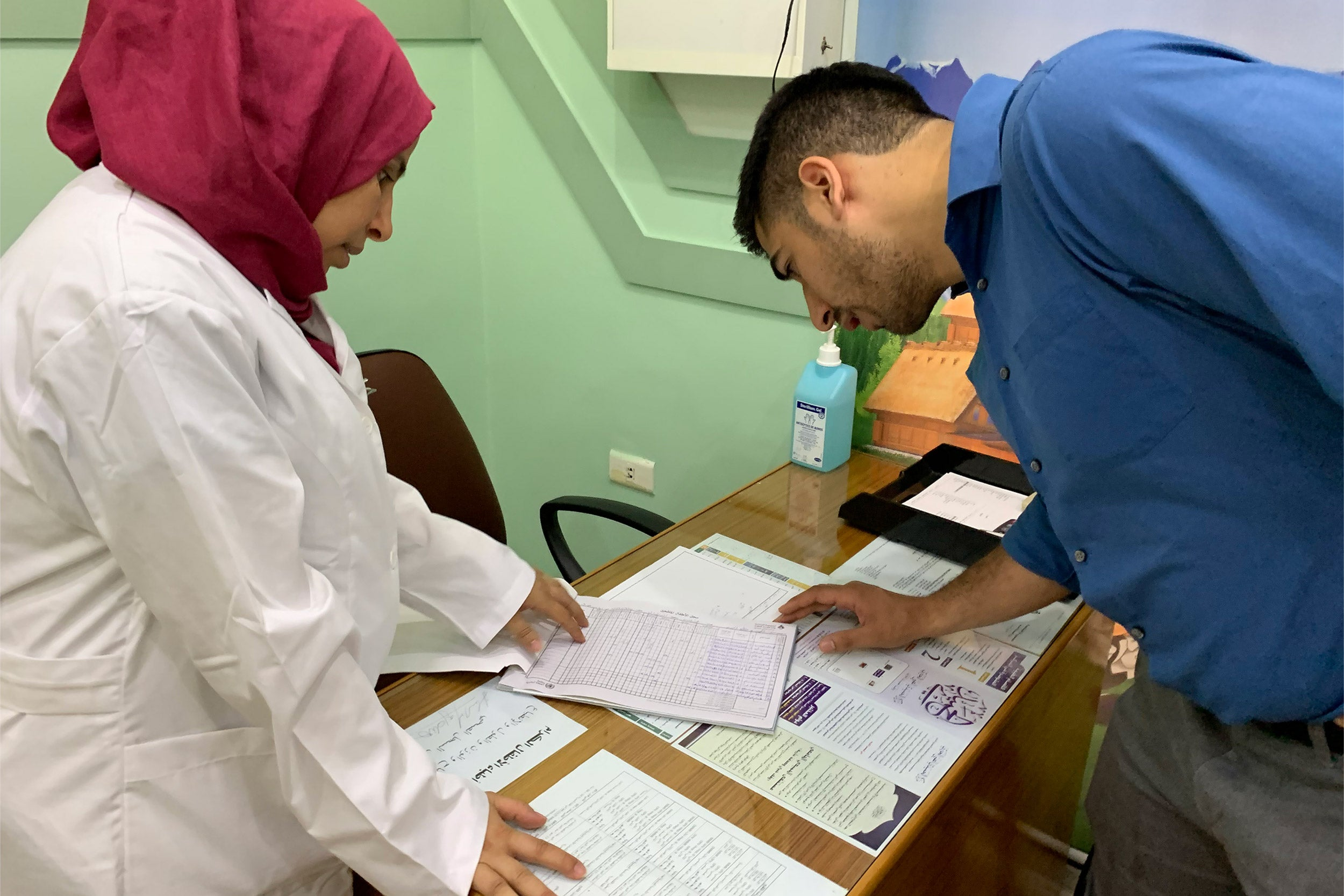 Inspecting medical documents in Tripoli.