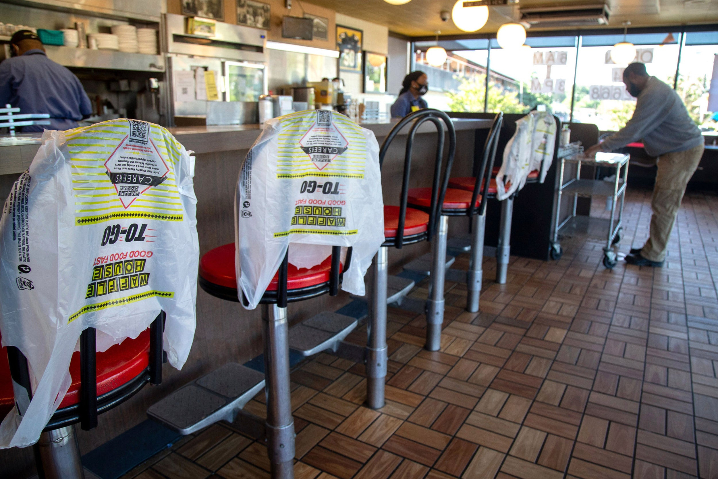 Customer picks up order in Waffle House.