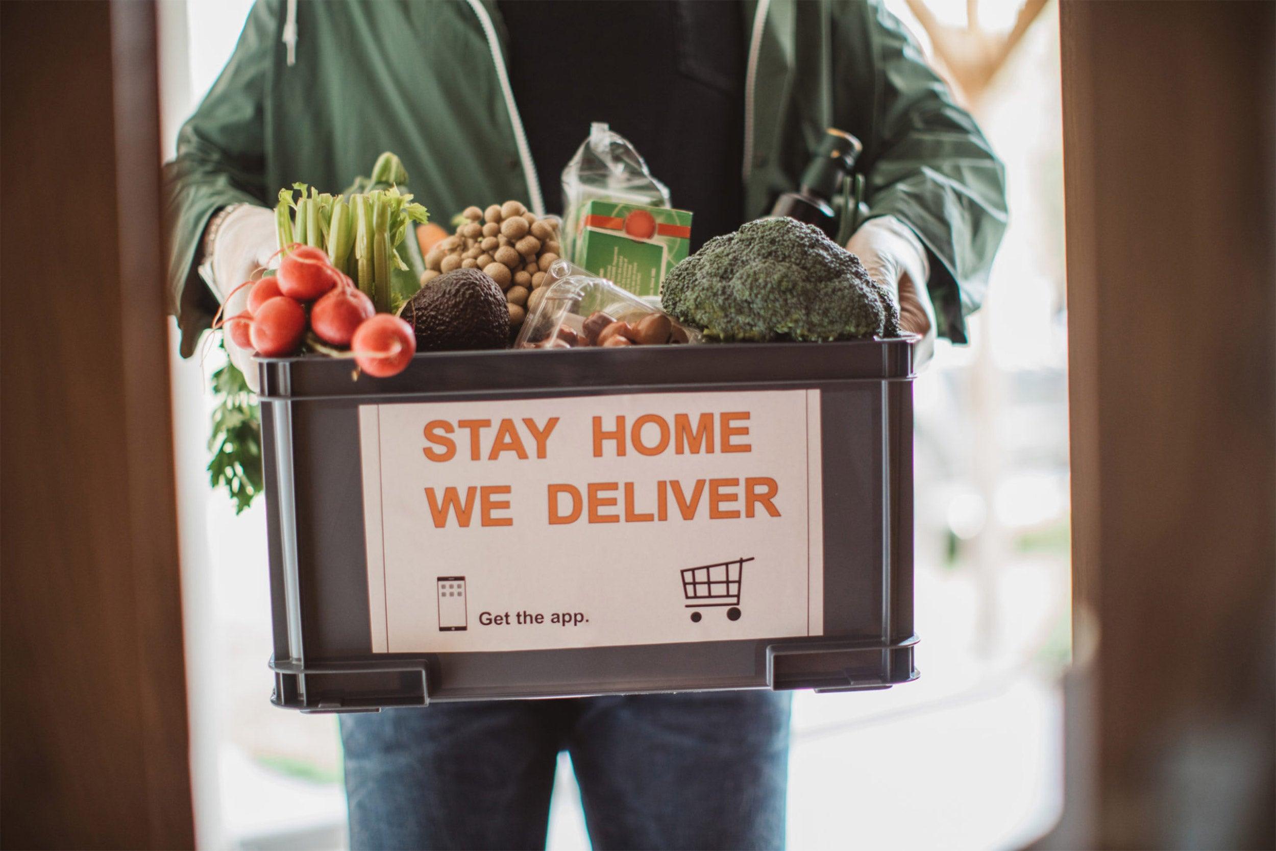 Man holding box of food.