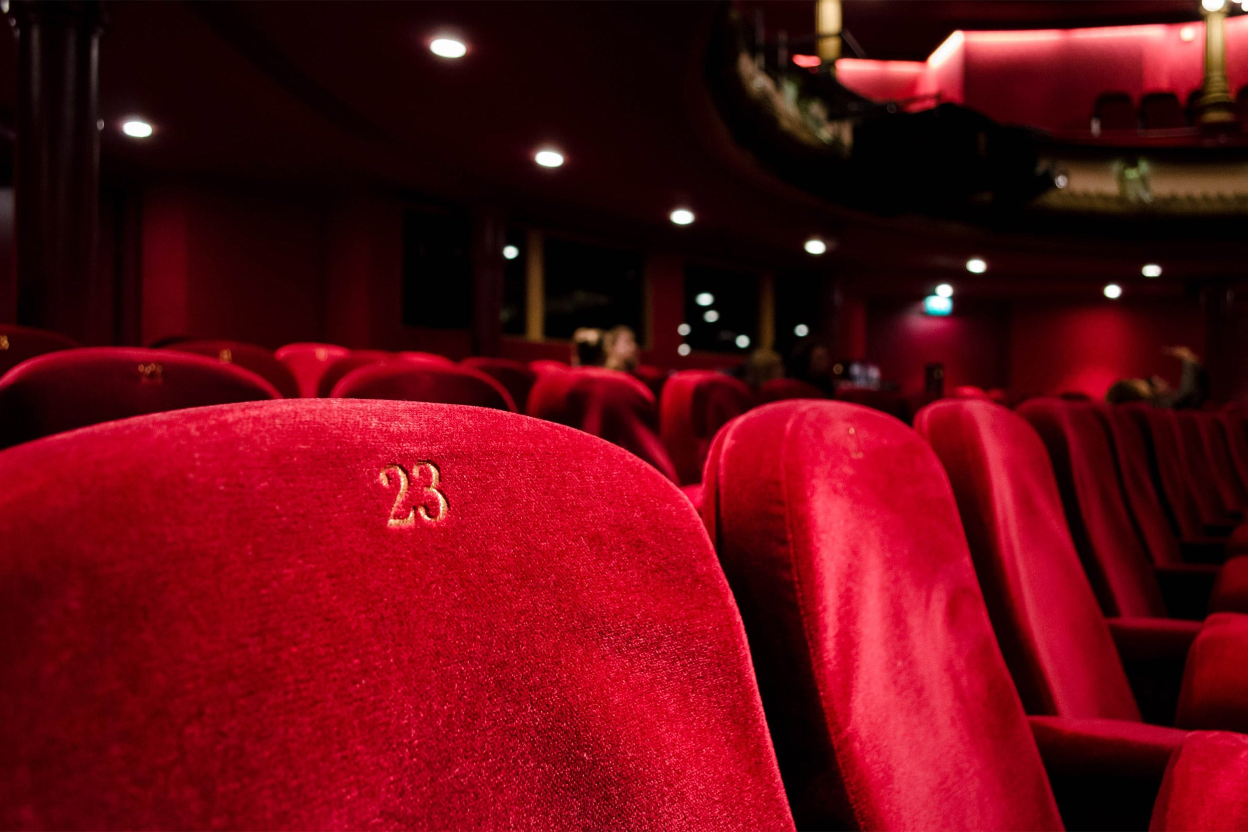 Empty theater chairs.