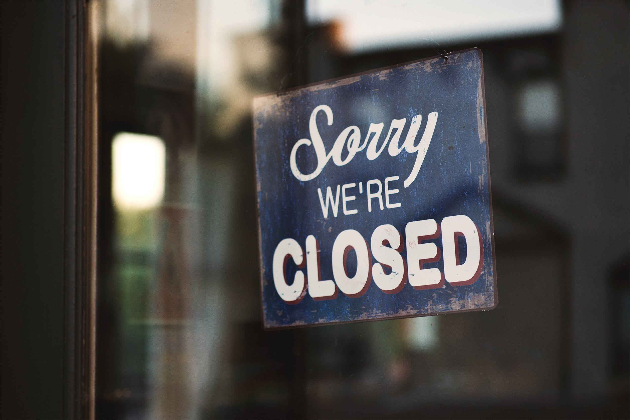 Closed sign in door.