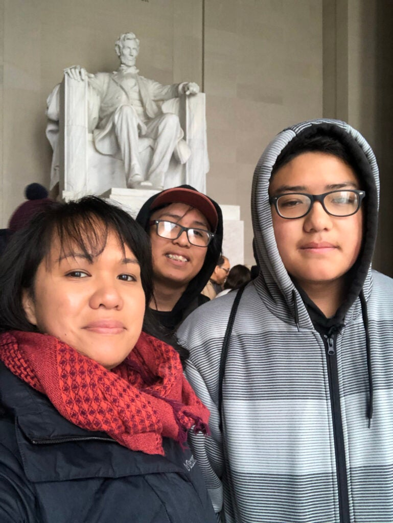 Heidi Brandow with her two sons Kian, 14, center, and Mateo, 15.