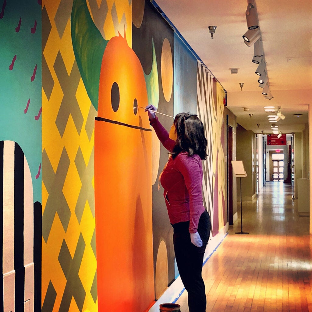 Heidi Brandow paints a mural at the Museum of Contemporary Native Arts in Santa Fe, New Mexico.