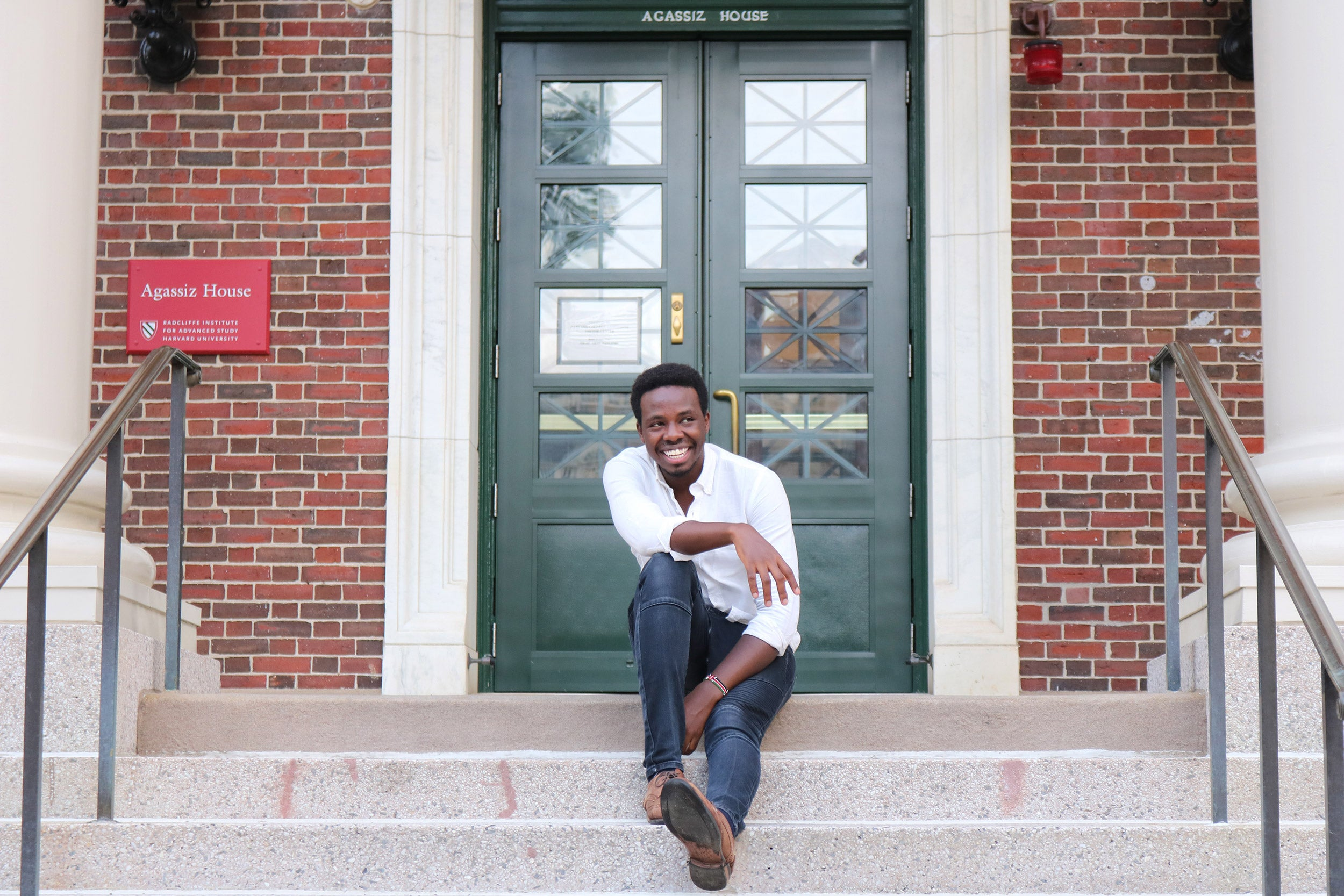 Billy Koech sitting on stairs at Harvard.