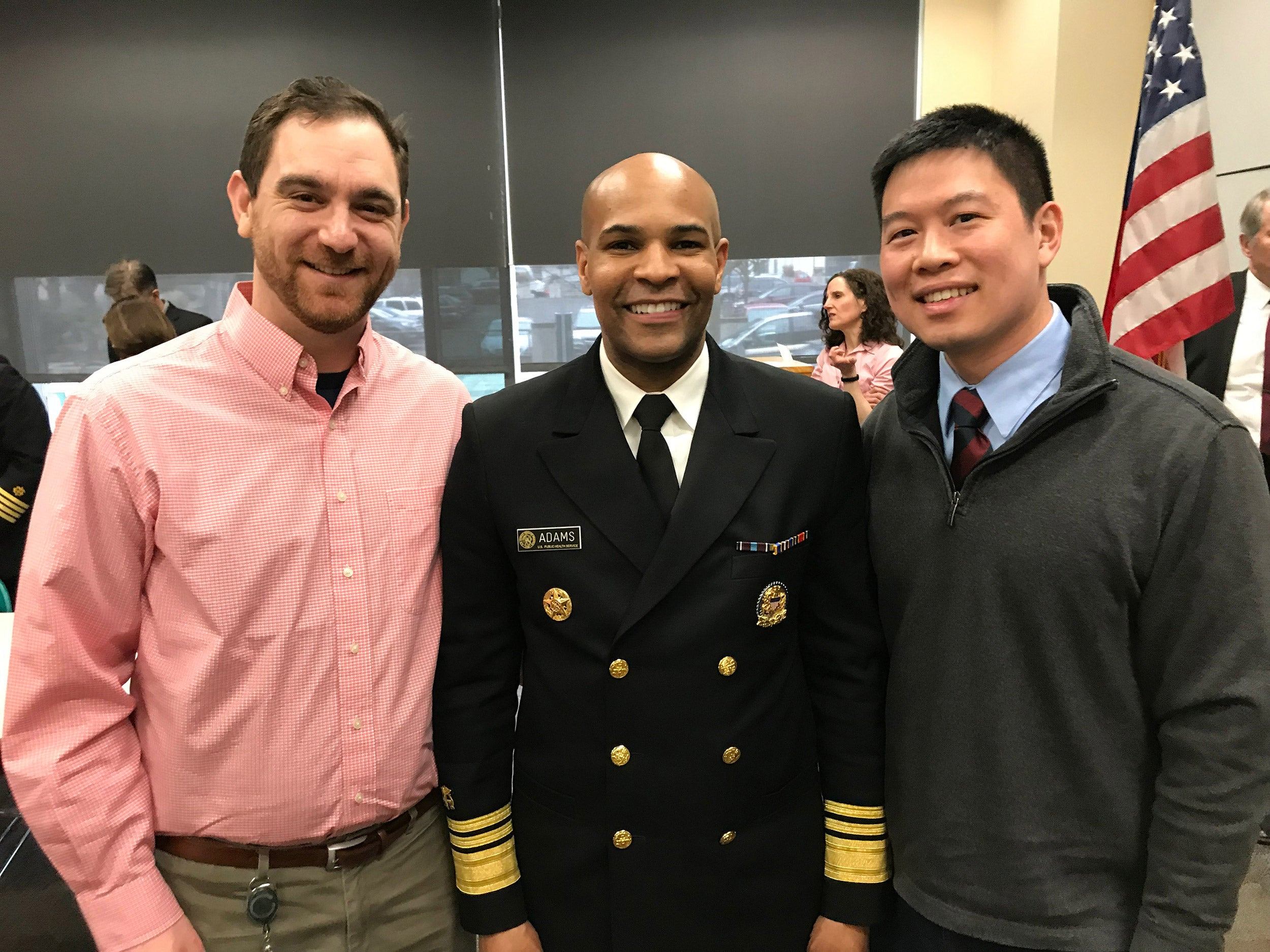 Officer Steven Rekant, US surgeon General Jerome M. Adams adn Alex Wu.