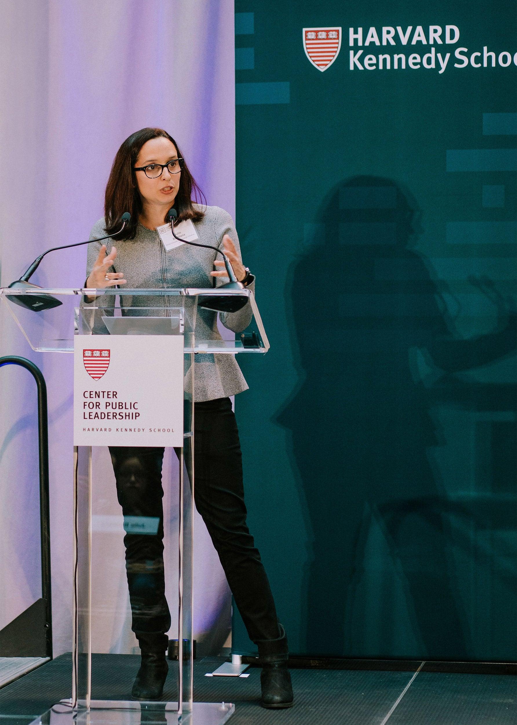 Professor Battilana standing at podium.