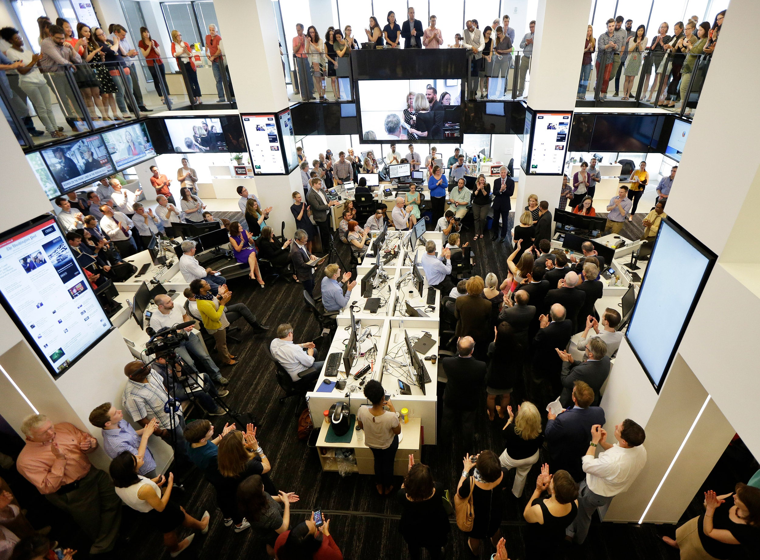 Washington Post newsroom after getting 2016 Pulitzer Prize for National Reporting.