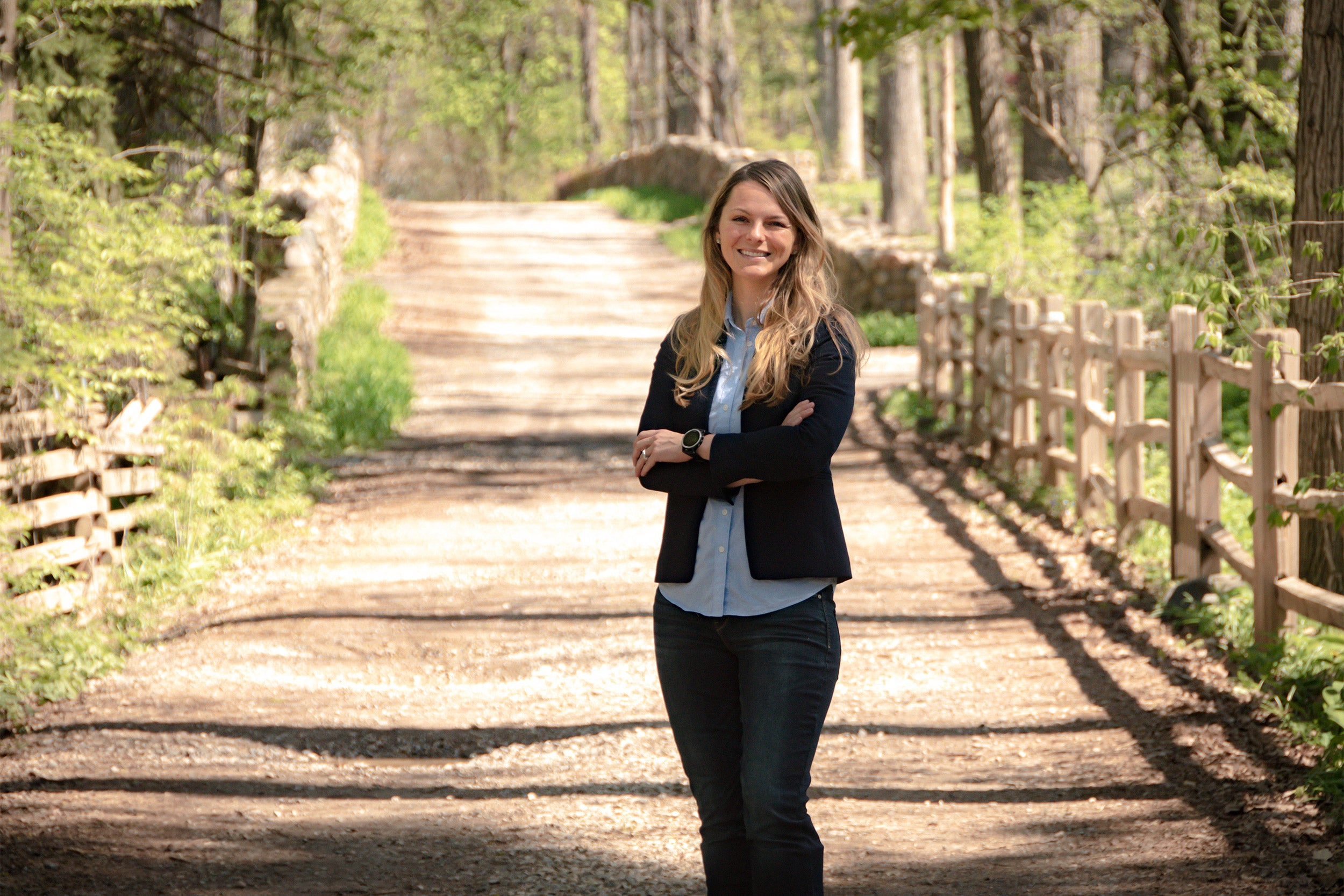 Kirstin Woody Scott on dirt road.