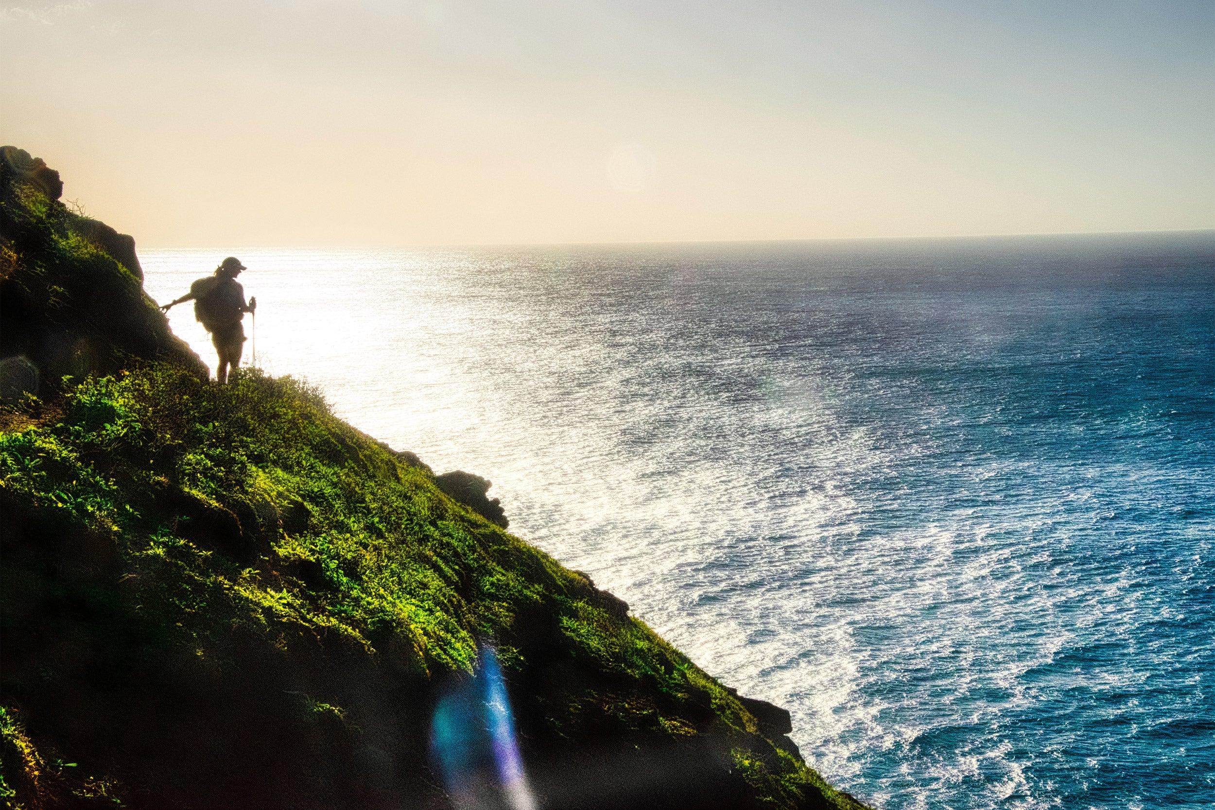 Kirstin Woody Scott on cliff overlooking ocean.