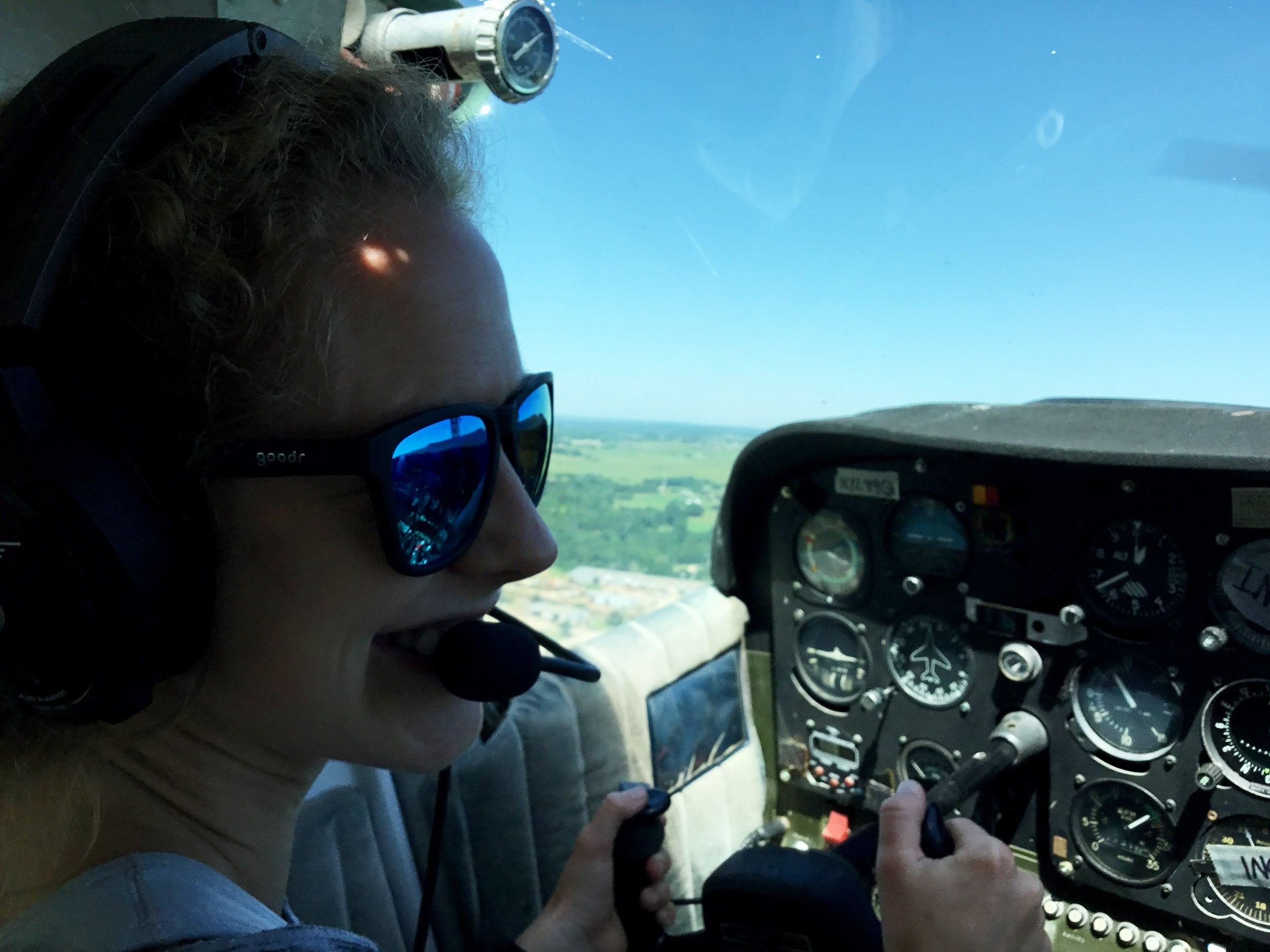 Lauren Spohn piloting a plane.