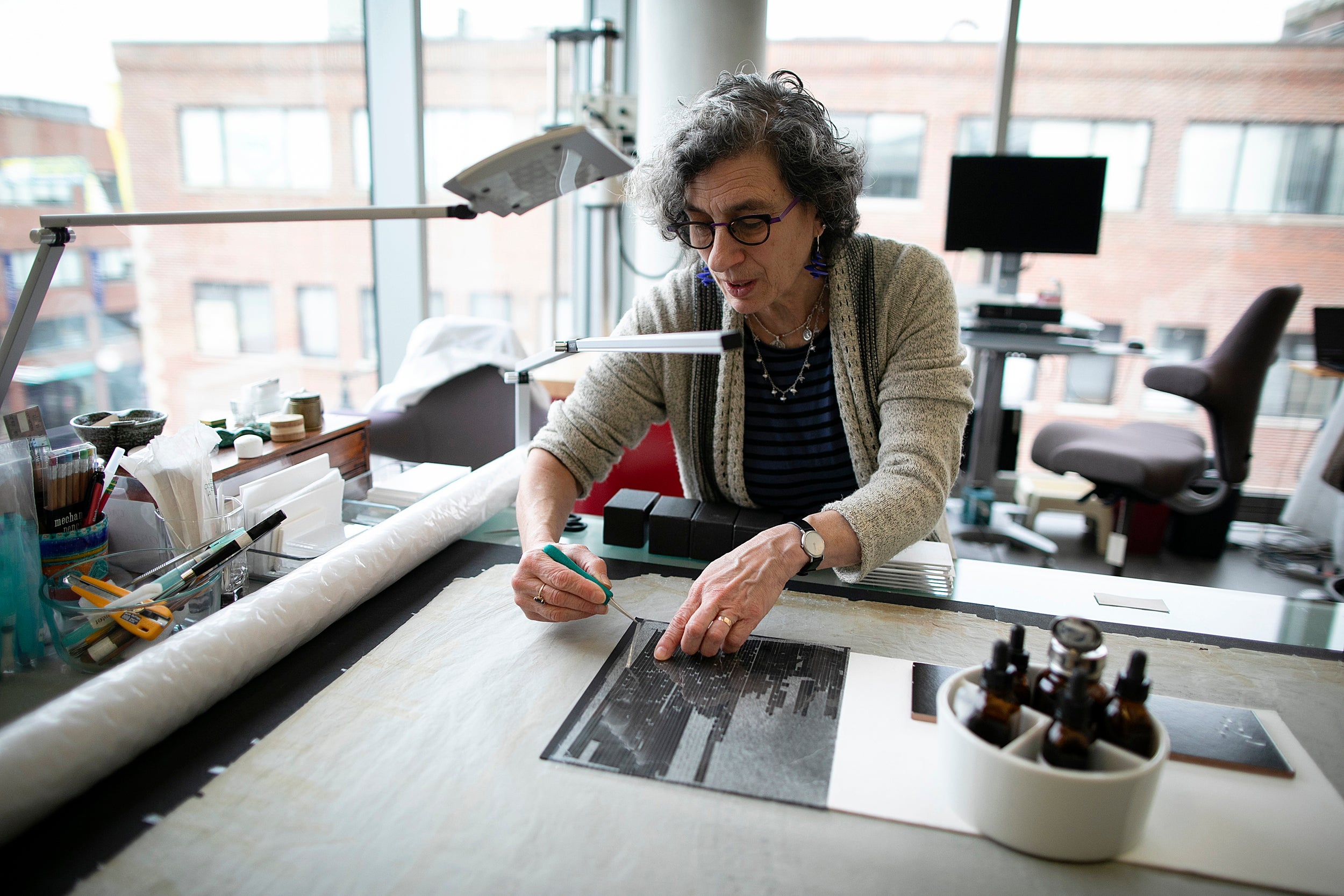Debora Mayer is pictured working in the center.