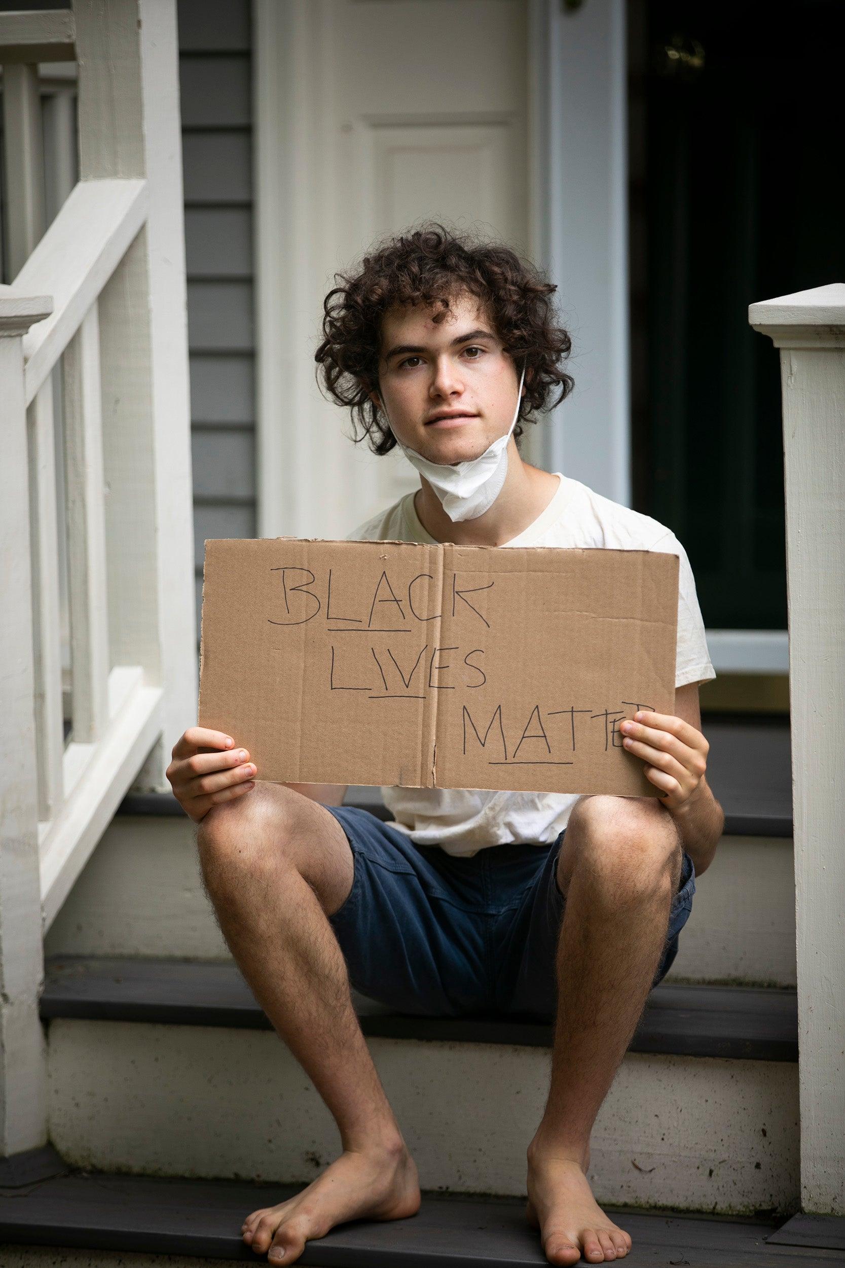 Jeremy Ornstein holds Black Lives Matter sign.