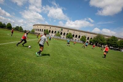 Women playing soccer.