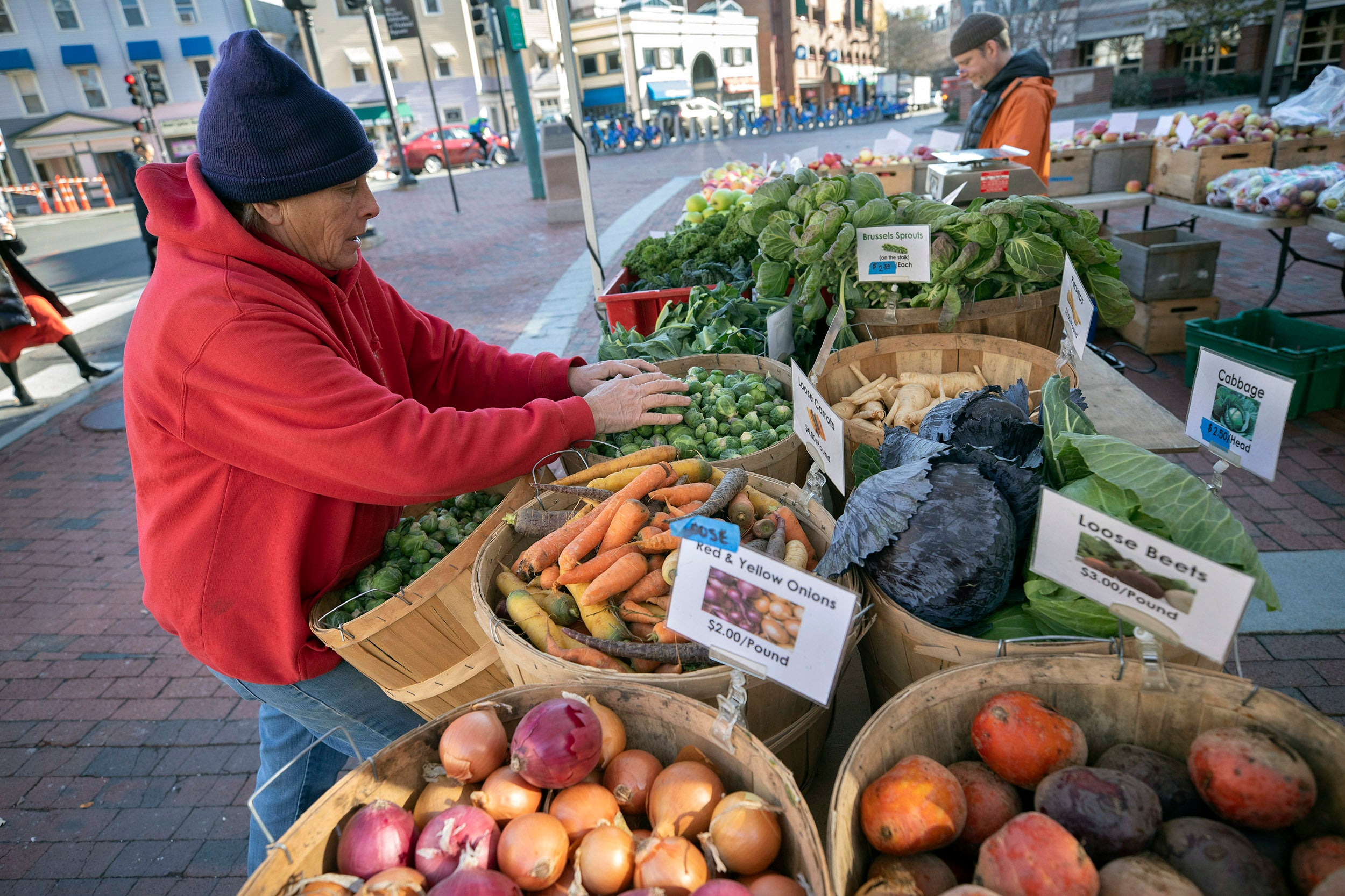 At the farmer's market, Wendy Long Land sets up Kimball's Fruit Farm Stand outside Harvard Kennedy School.