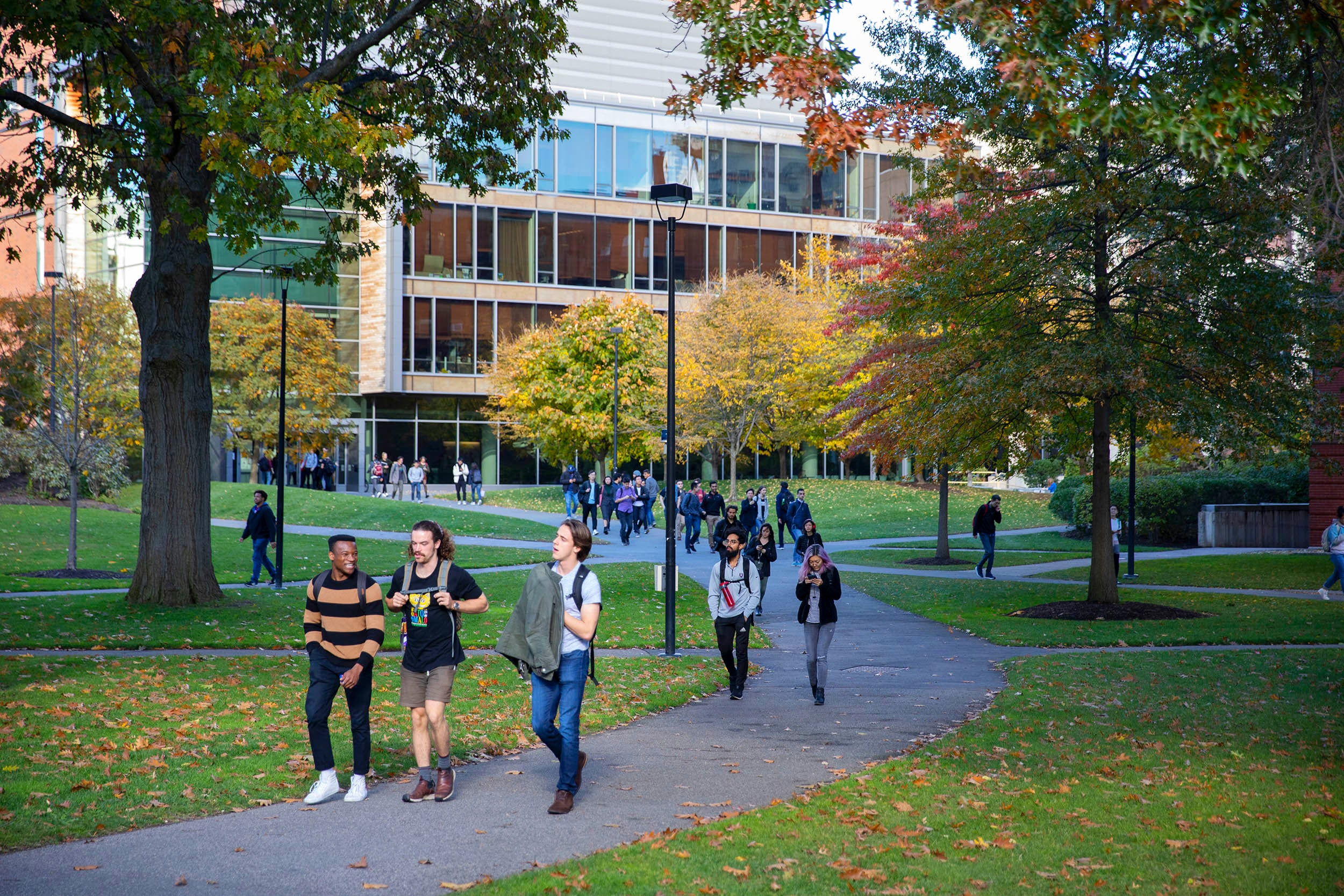 Students leave class outside the Northwest Labs in autumn.