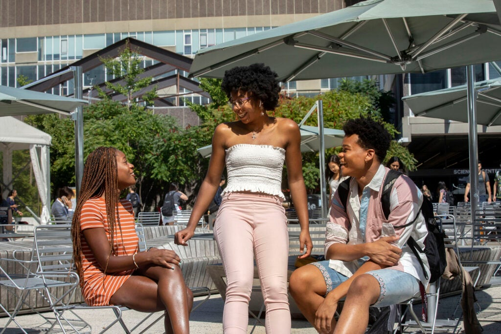 Marissa Joseph '23 (from left) Jarah Cotton '23, and Christian Porter '23 chat in the Science Center Plaza.