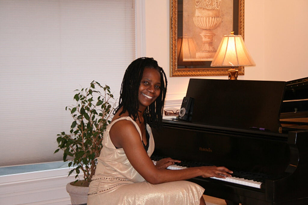Deborah Brown playing piano.