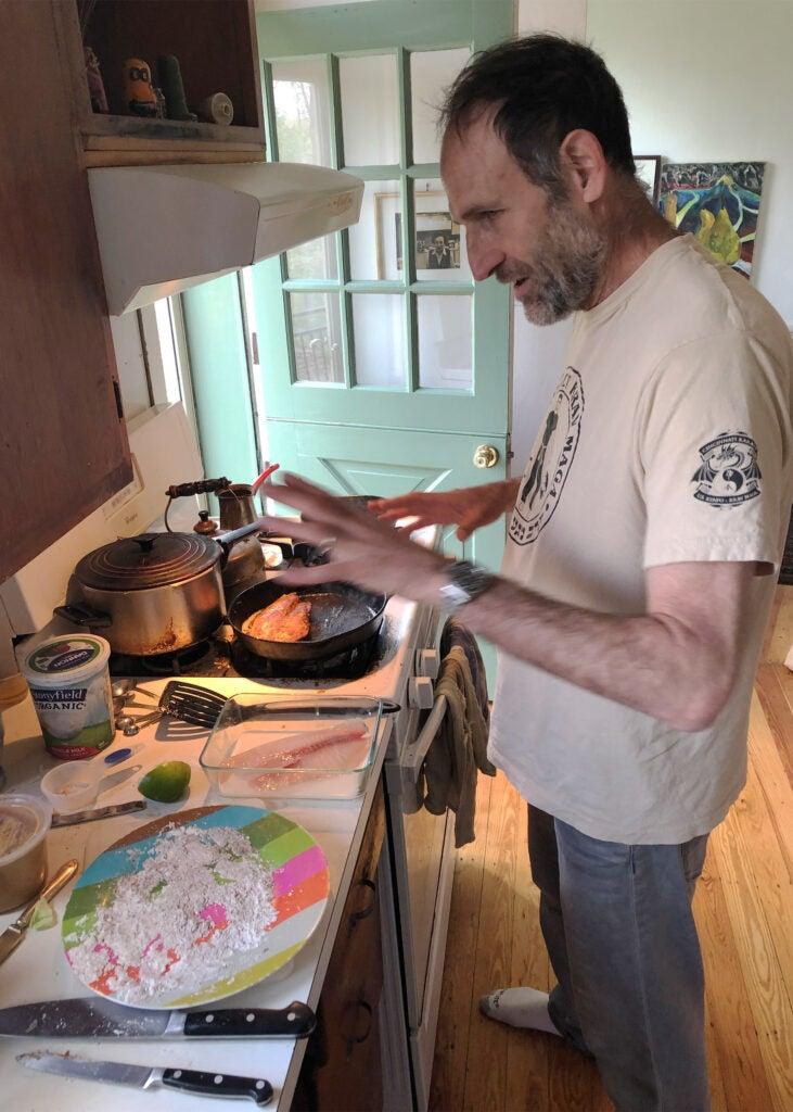 Uri Sella makes fish tacos.