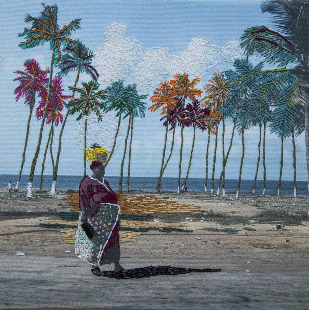 Embroidered photograph of woman walking by palm trees.