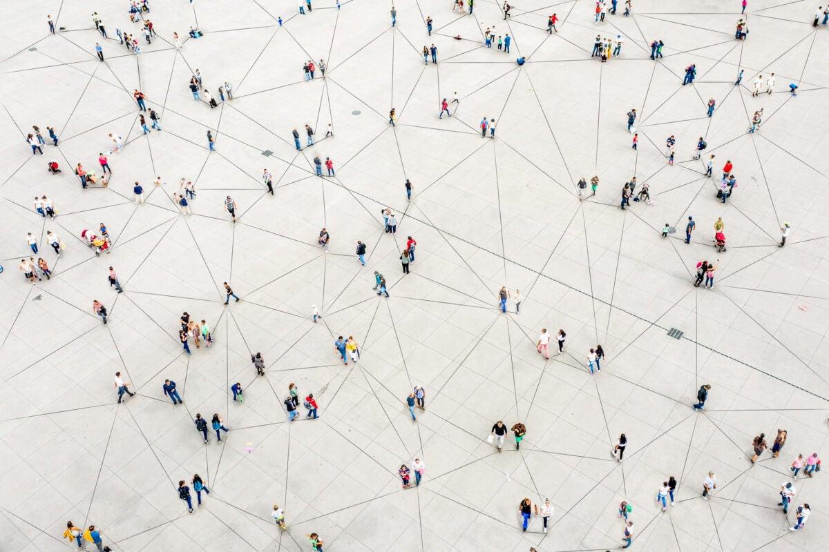 Illustration of people linked together.