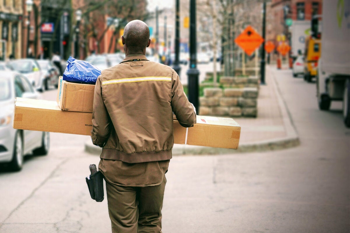 A delivery man with pacakges.