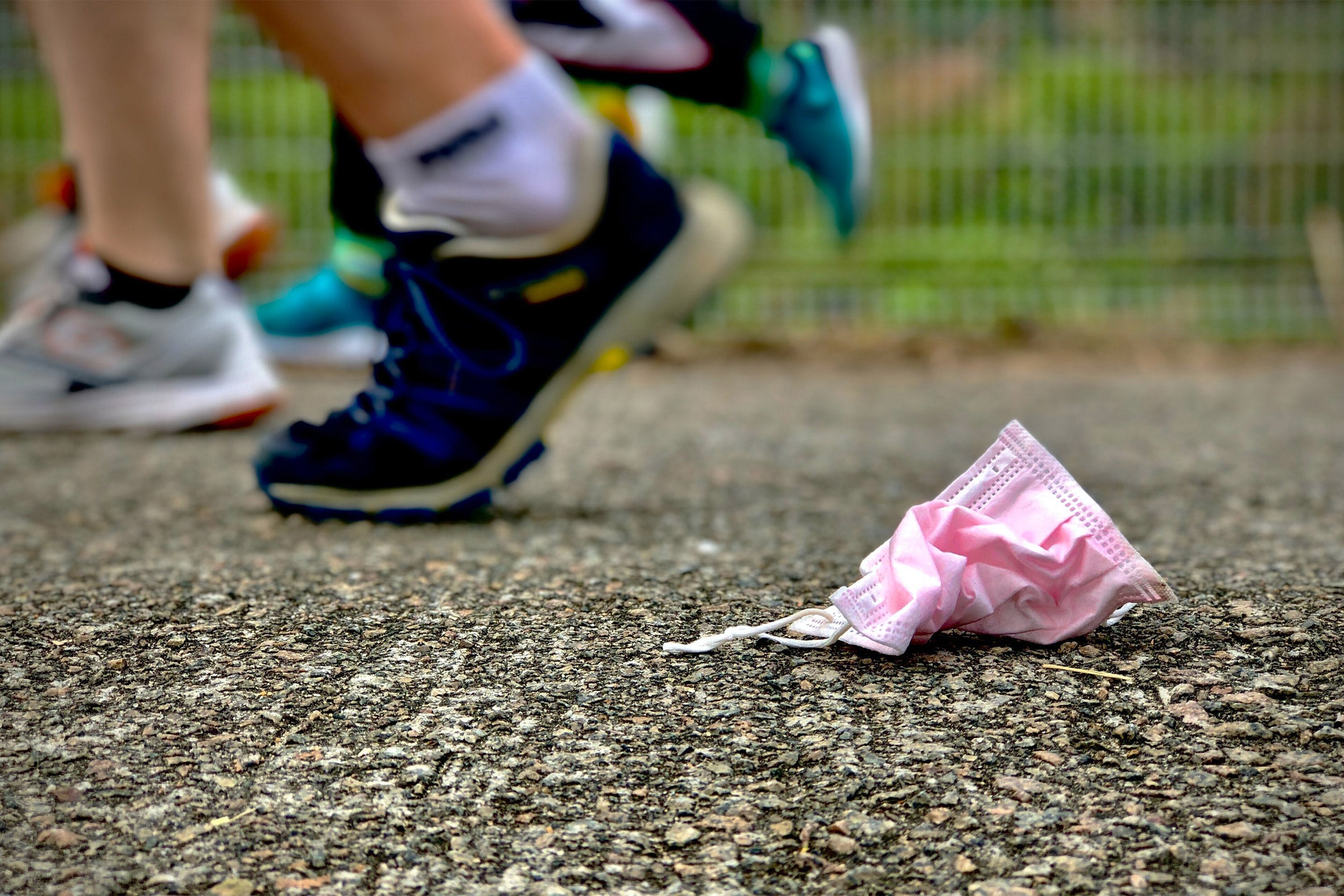 Runners and mask on ground.