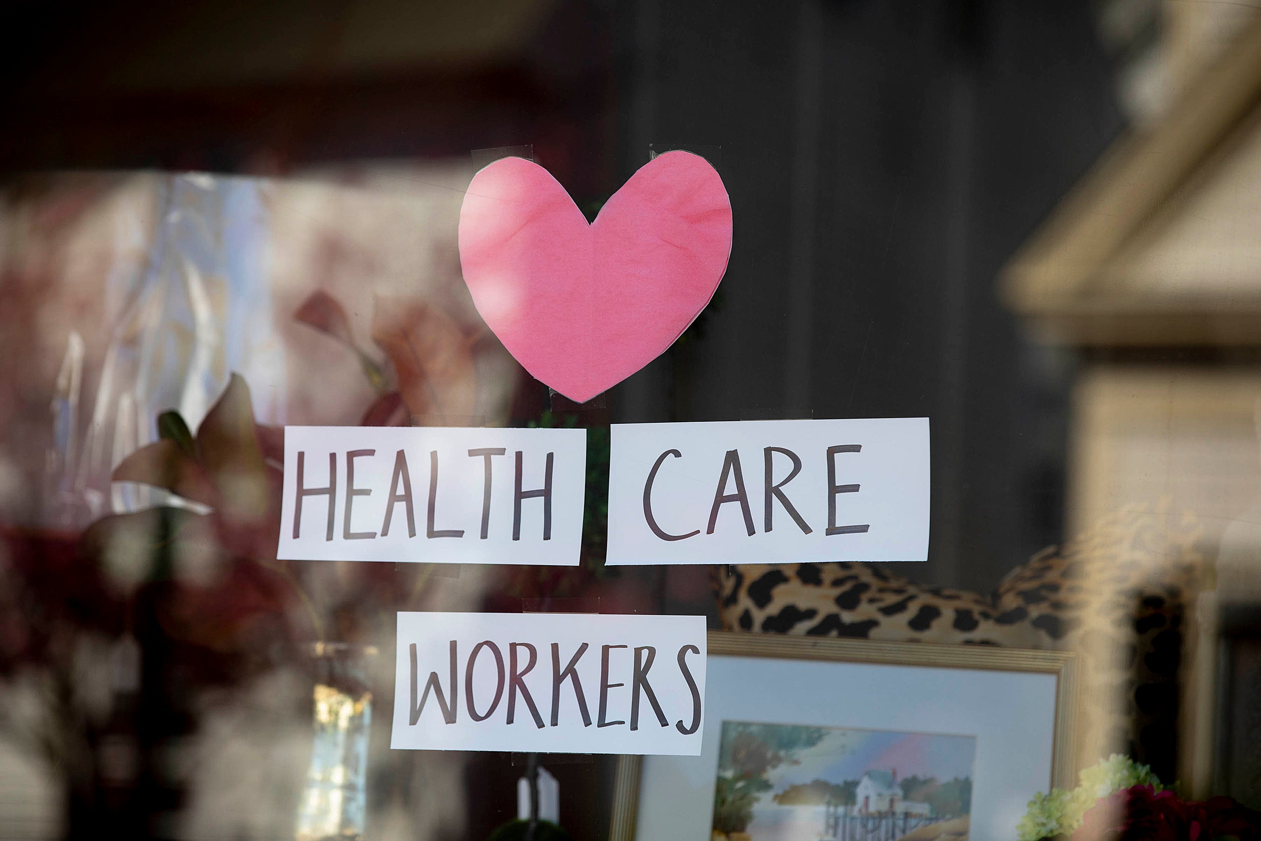 Thank you sign for health care workers in a window.