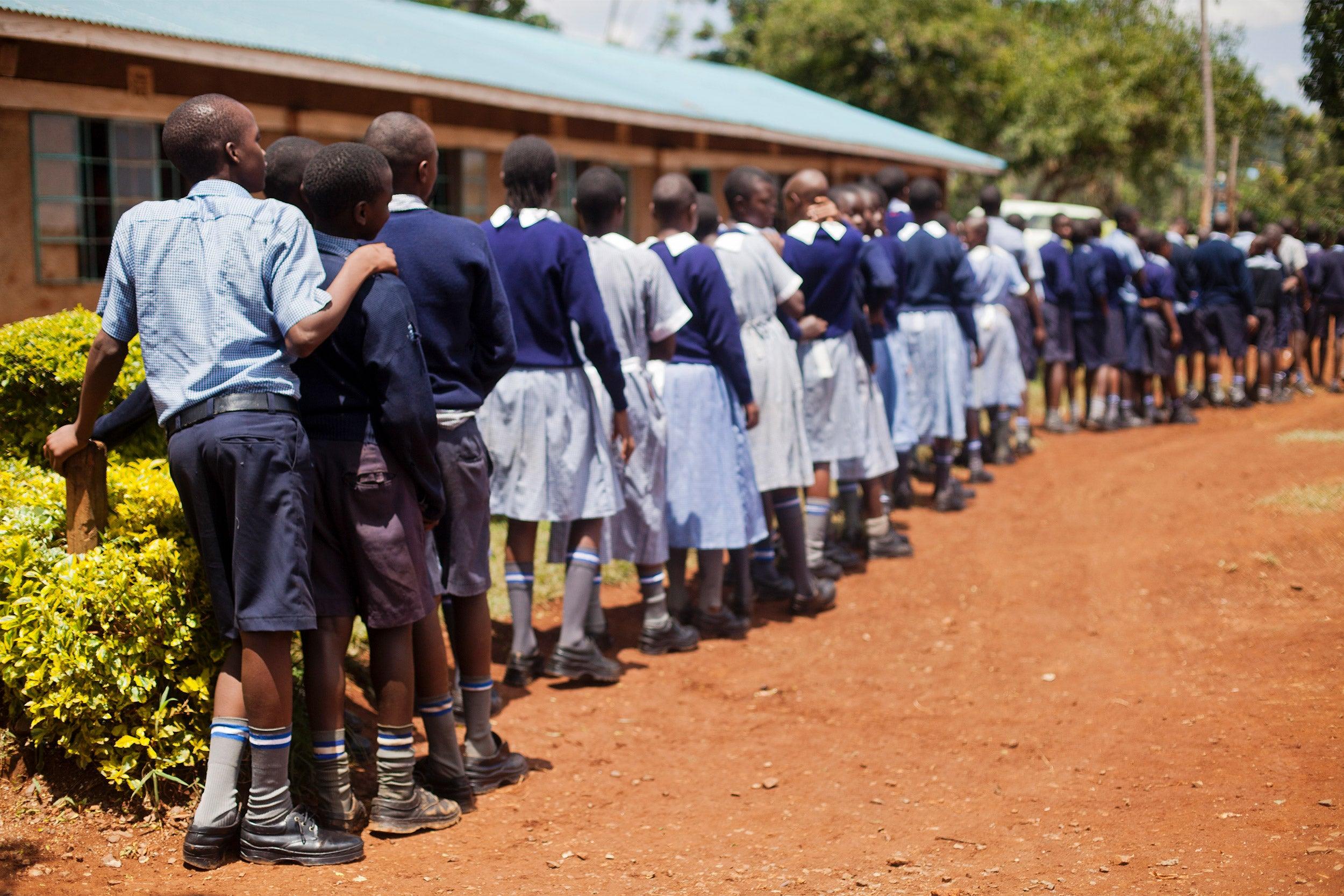 Schoolchildren standing in line.