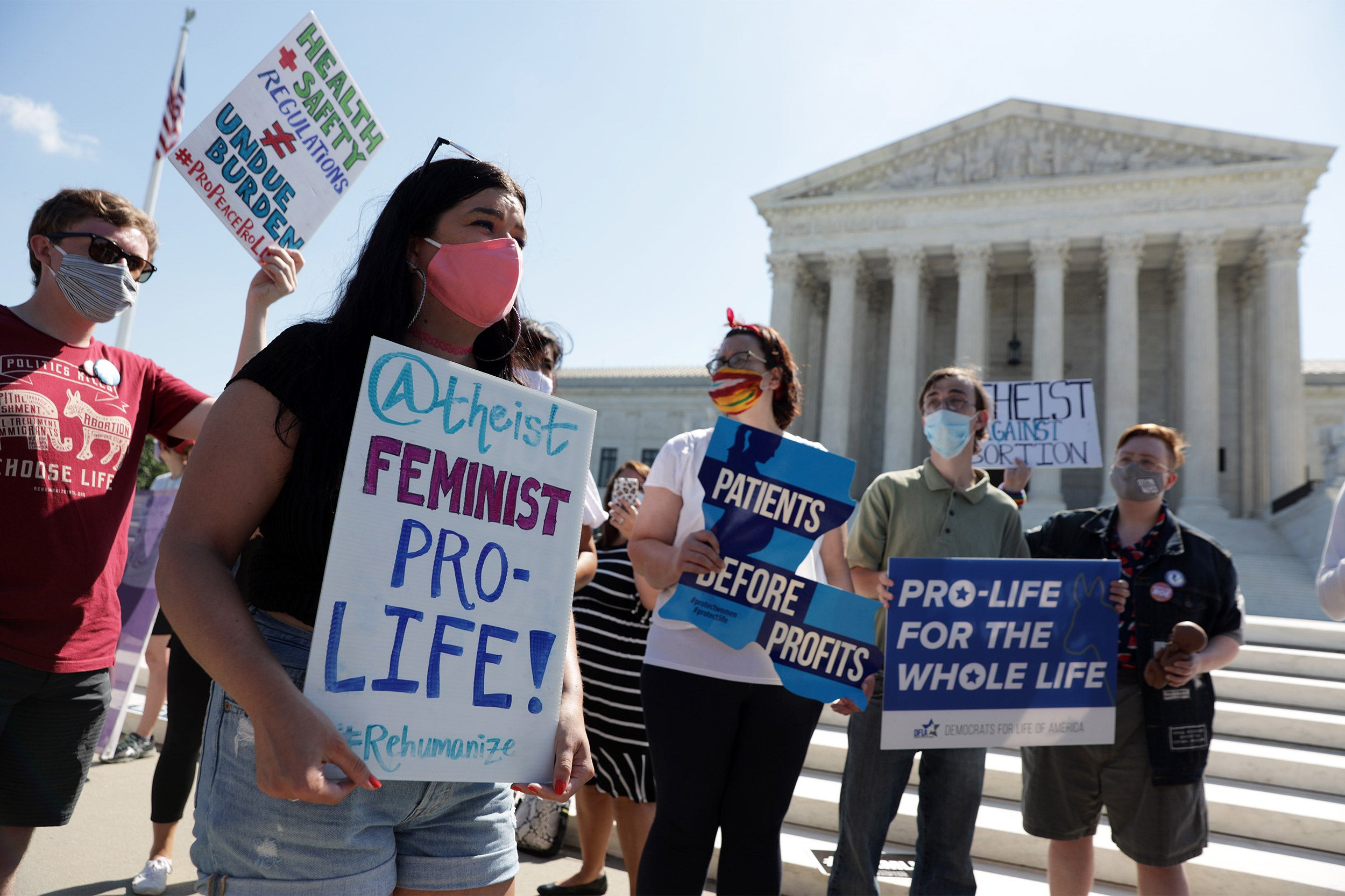 Pro-life activists participate in a demonstration in front of the U.S. Supreme Court on June 29.