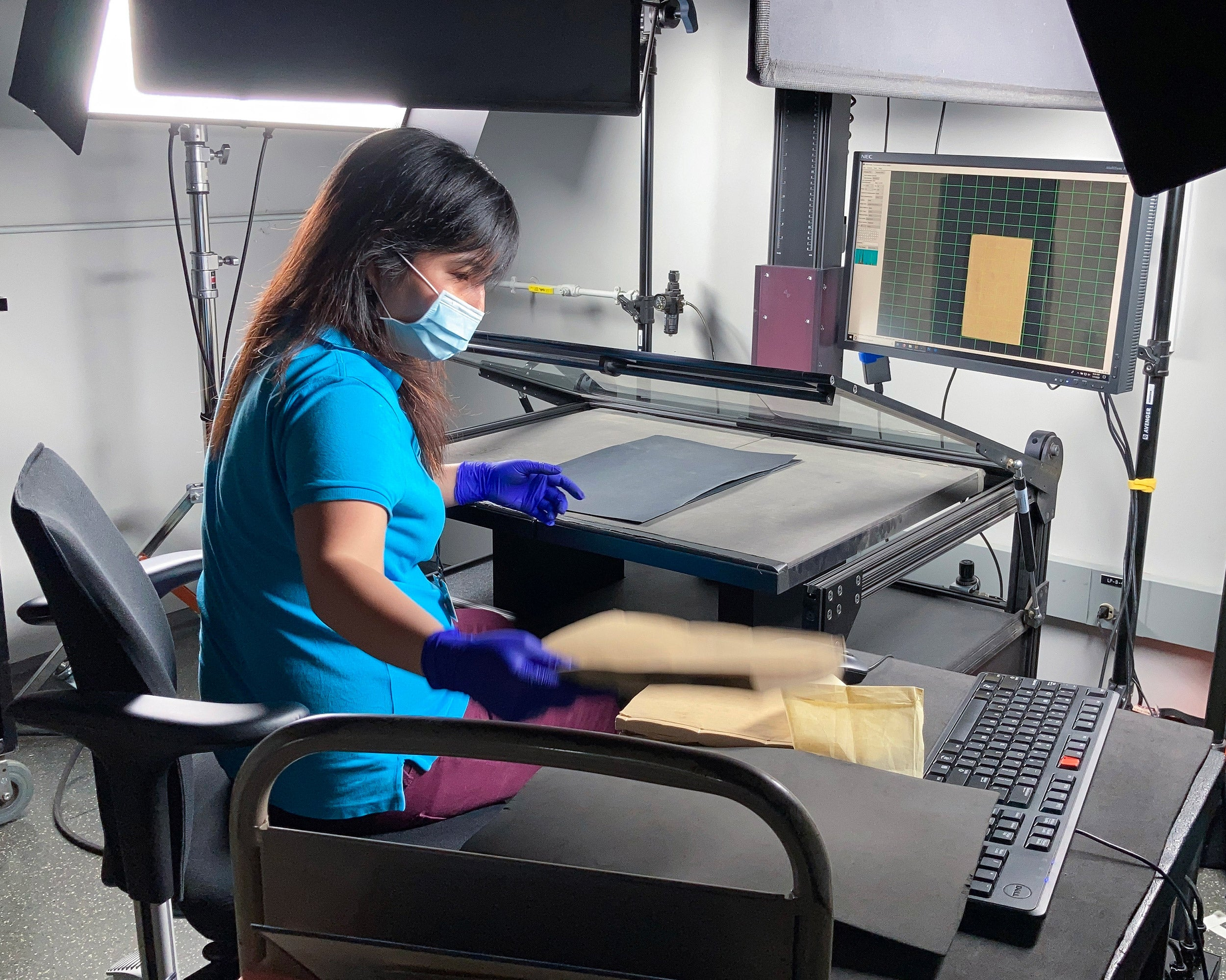 Penny Xu scanning a book.