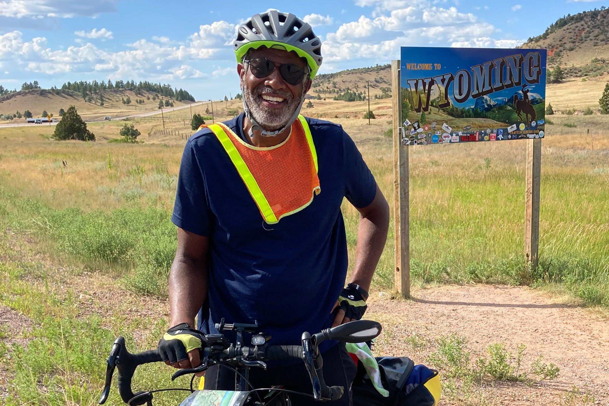 Scott Edwards on bicycle entering Wyoming.