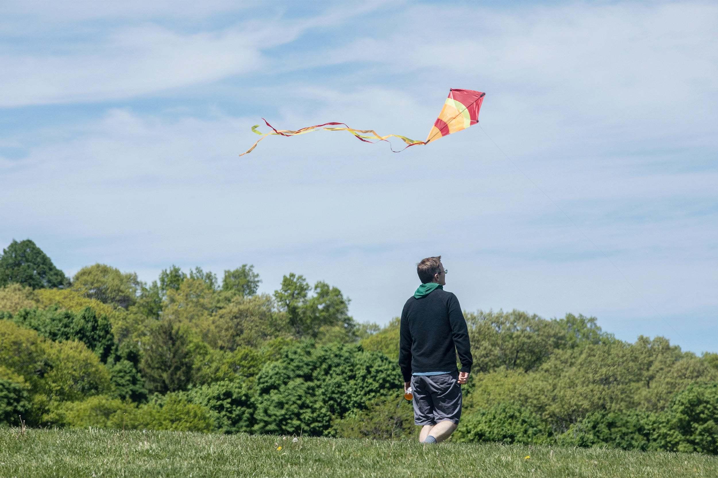 Man flying kite.