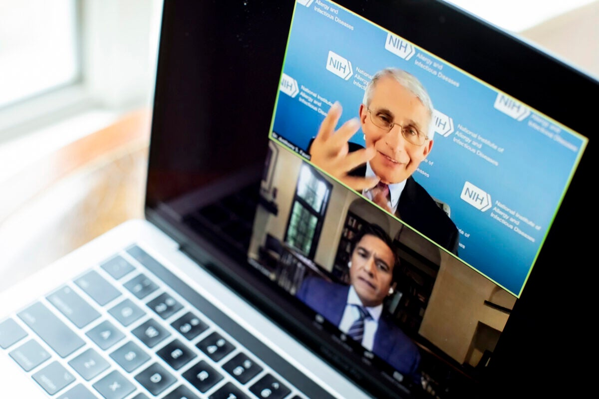 Anthony Fauci (top) answers a question from Sanjay Gupta,the chief medical correspondent at CNN.